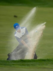 Memorial's Justin Drake hits out of the bunker at the 10th hole at Victoria National Golf Club Saturday afternoon.