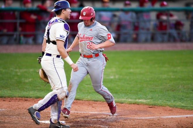 Indiana University's Elijah Dunham (21) steps on the plate to score a run as the Evansville Aces play Indiana University at Evansville's Braun Stadium April 12, 2019.