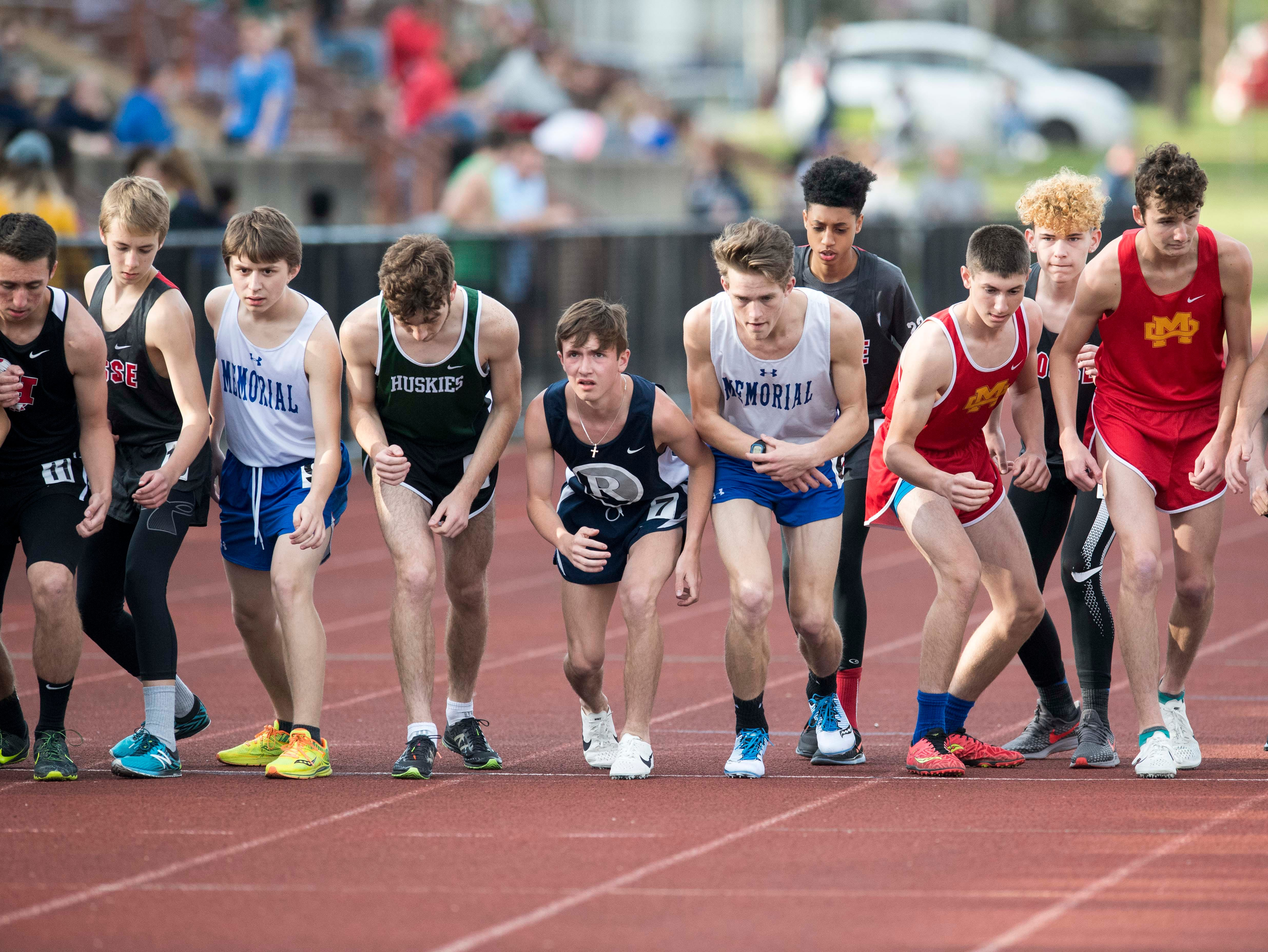 Runs set for the boys 1600m run during the 2019 City Track and Field meet at Central High School Friday, April 12, 2019.