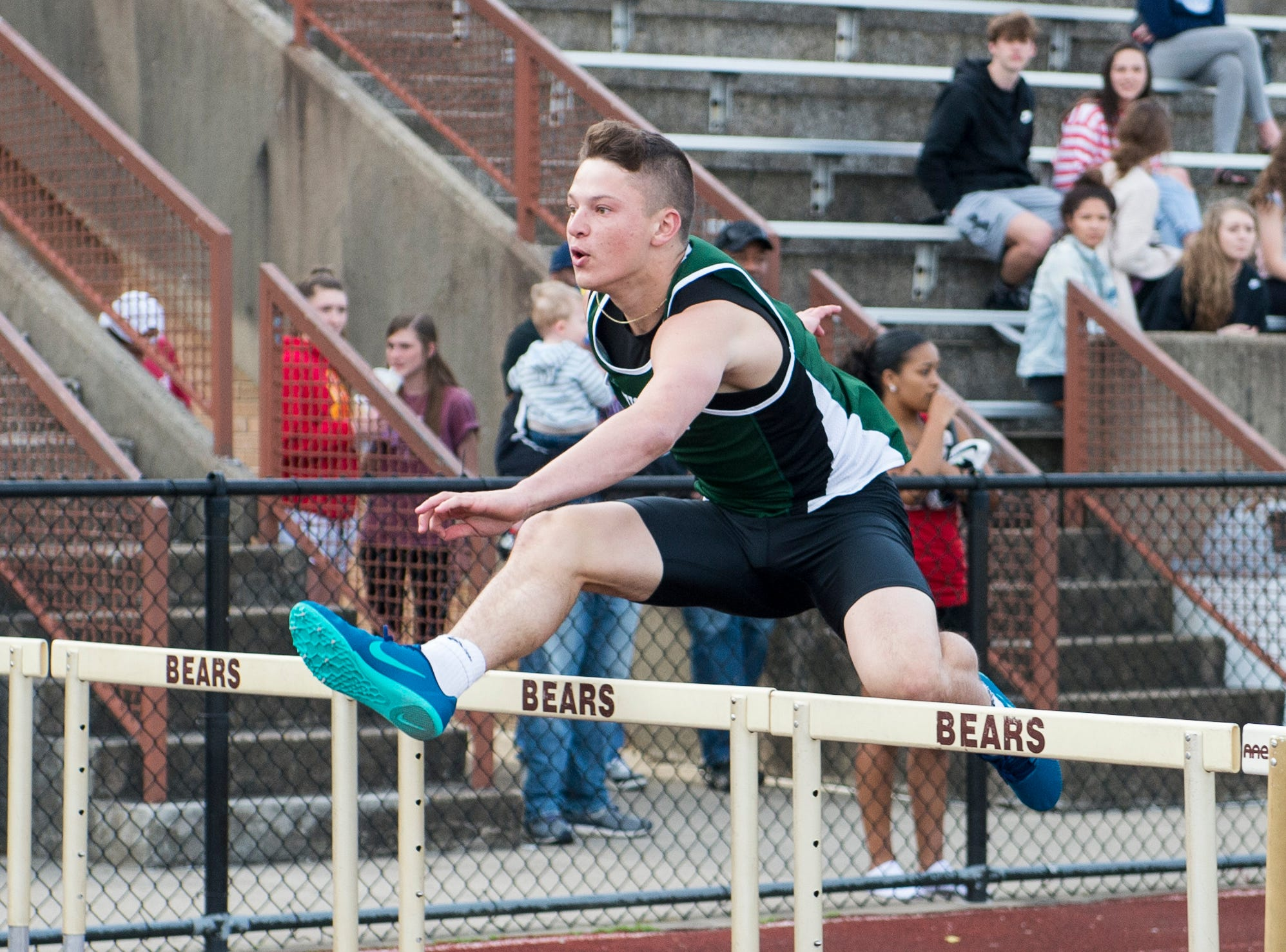 North's Dylan McKinney clears a hurdle in the boys 110m high hurdle event during the 2019 City Track and Field meet at Central High School Friday, April 12, 2019.  McKinney took first place in the event at 15.7 seconds.