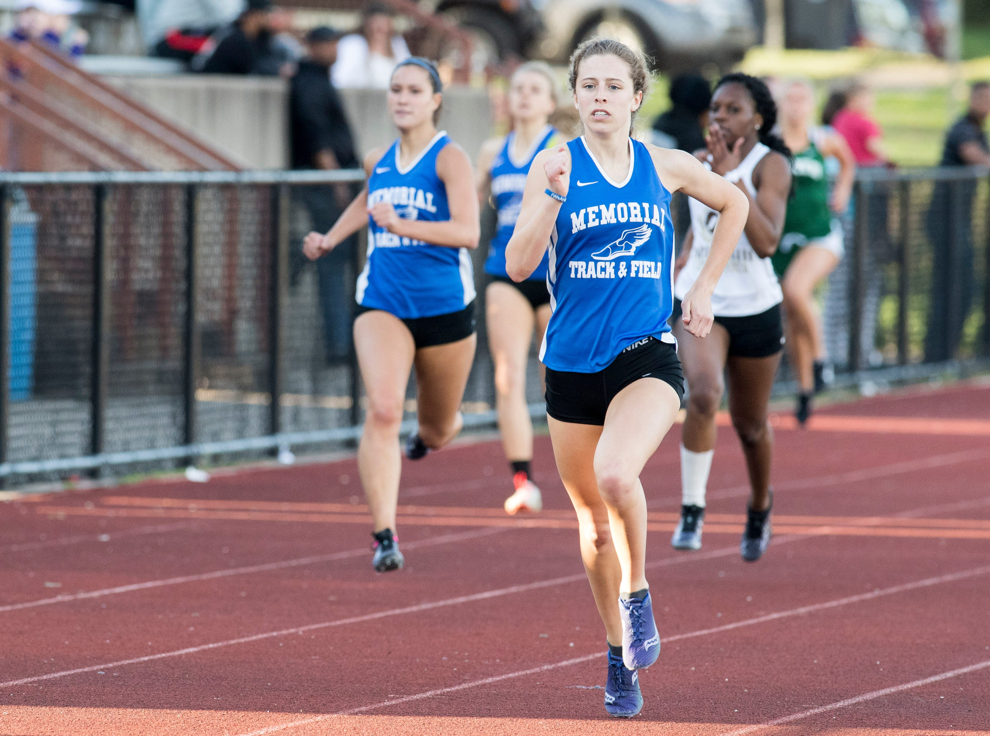 Memorial's Ellen Hayhusrt leads in the 400m relay event during the 2019 City Track and Field meet at Central High School Friday, April 12, 2019.