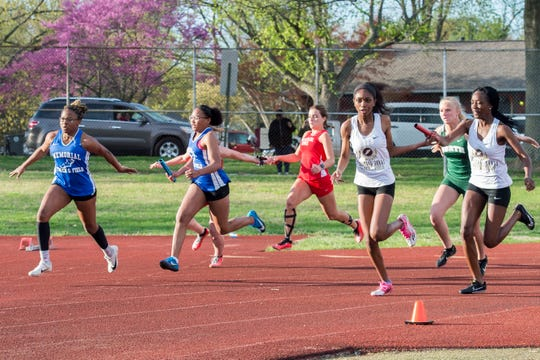 Runners participate in the girls 400m relay during the 2019 City Track and Field meet at Central High School Friday, April 12, 2019.