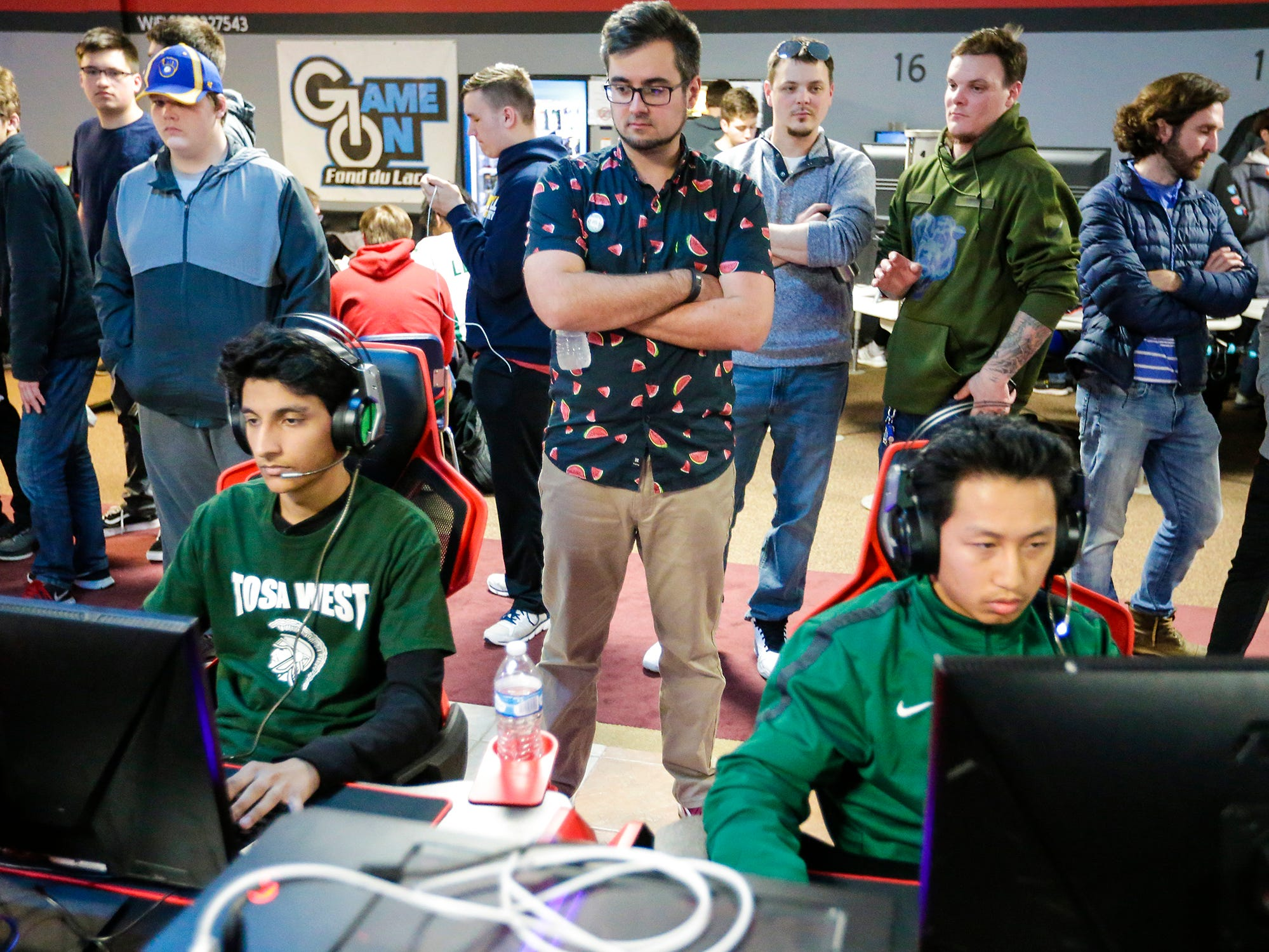 Mike Dahle, President of the Wisconsin High School Esports Association watches Abdul Bhatti and Destyn Lee play a video game at the Wisconsin High School Esports Association's State Championship Saturday, April 13, 2019 at Game On in Fond du Lac Wisconsin. Teams from all over Wisconsin compete in 4 games during the event. Overwatch, Rocket League, League of Legends, and Smash Ultimate. Doug Raflik/USA TODAY NETWORK-Wisconsin