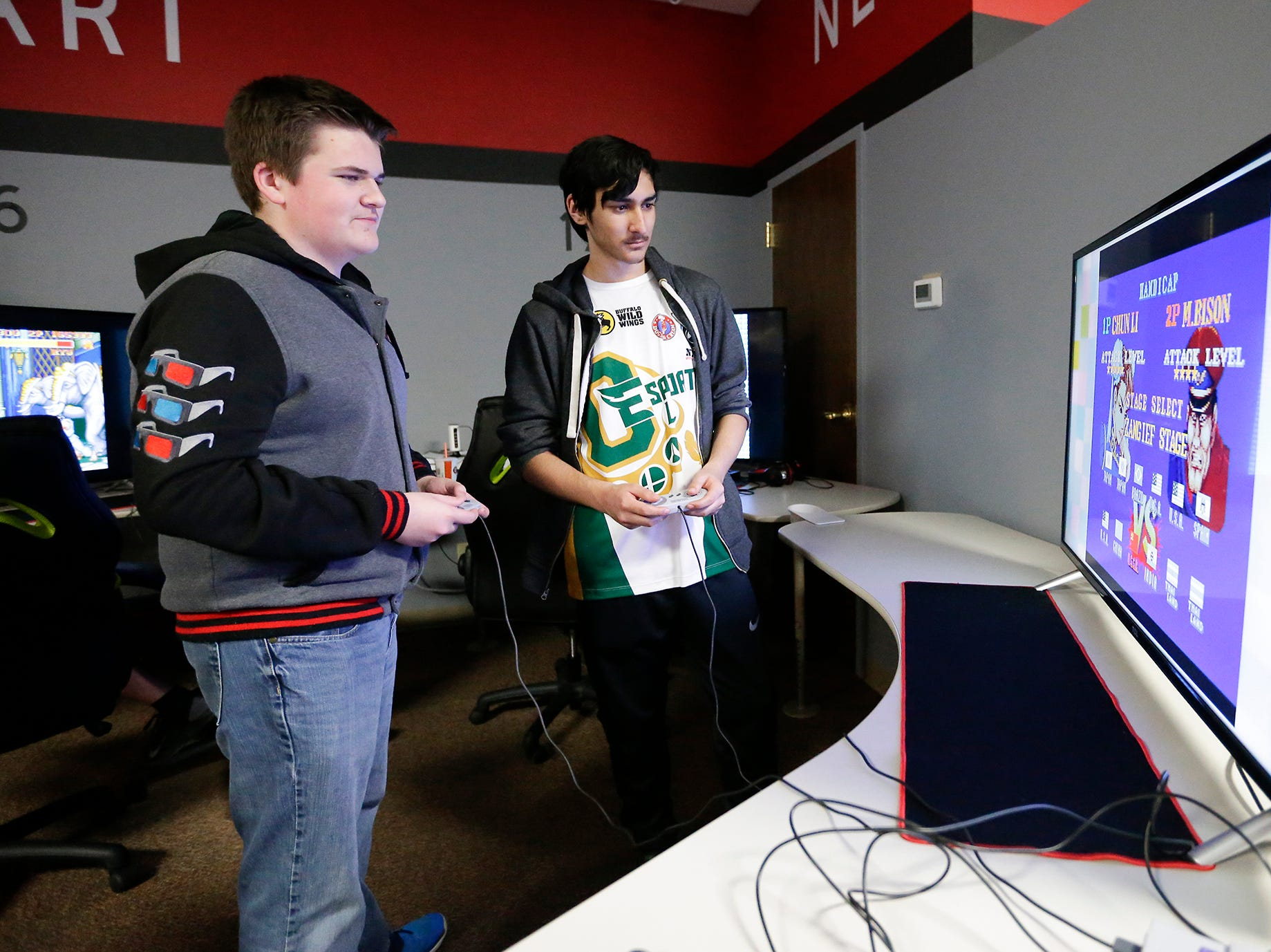 Luke Navin and Addison James-Perkins of Racine play a video game at the Wisconsin High School Esports Association's State Championship Saturday, April 13, 2019 at Game On in Fond du Lac Wisconsin. Teams compete in 4 games during the event. Overwatch, Rocket League, League of Legends, and Smash Ultimate. Doug Raflik/USA TODAY NETWORK-Wisconsin
