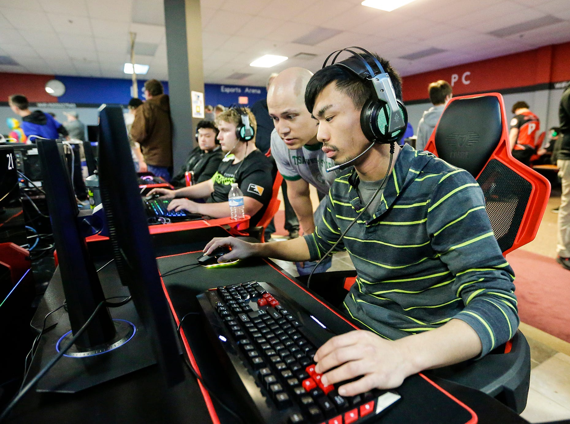 Game coach Bobby Dusel helps John Delacruze of Wauwautosa at the Wisconsin High School Esports Association's State Championship Saturday, April 13, 2019 at Game On in Fond du Lac Wisconsin. Teams compete in 4 games during the event. Overwatch, Rocket League, League of Legends, and Smash Ultimate. Doug Raflik/USA TODAY NETWORK-Wisconsin