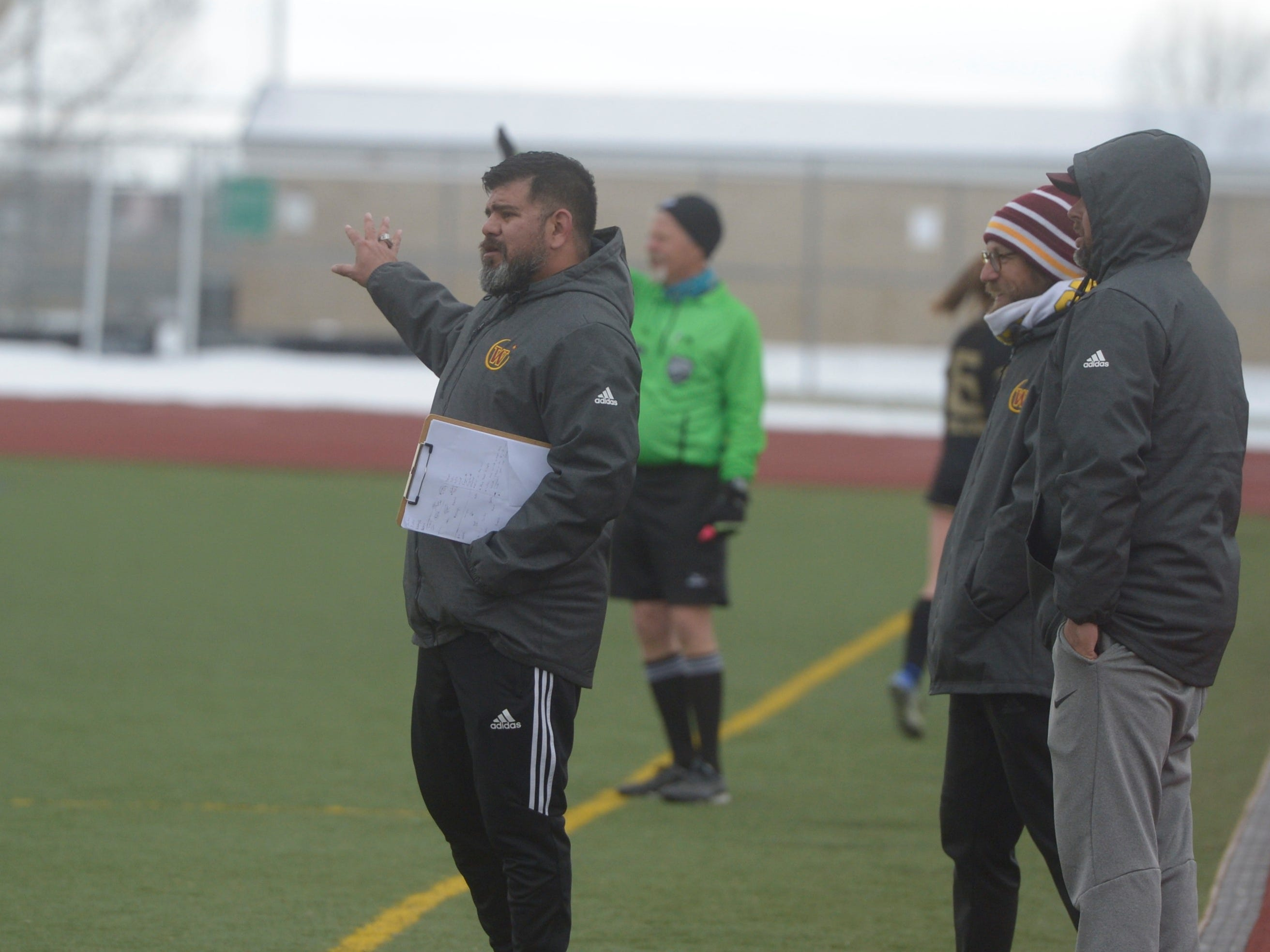 Windsor girls soccer coach Mario Garcia signals to players in a game Saturday, April 13, 2019 at Fossil Ridge. Windsor won 3-0.