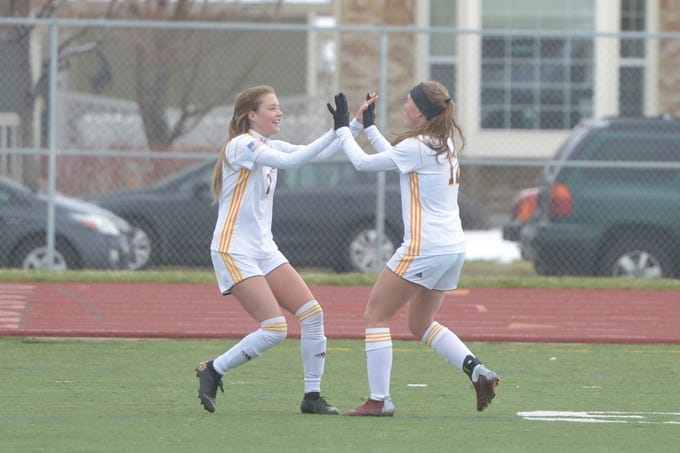 Windsor soccer players Alexa Kopren, left, and Abby Gearhart celebrate a goal against Fort Collins during a game Saturday, April 13, 2019 at Fossil Ridge. Windsor won 3-0.