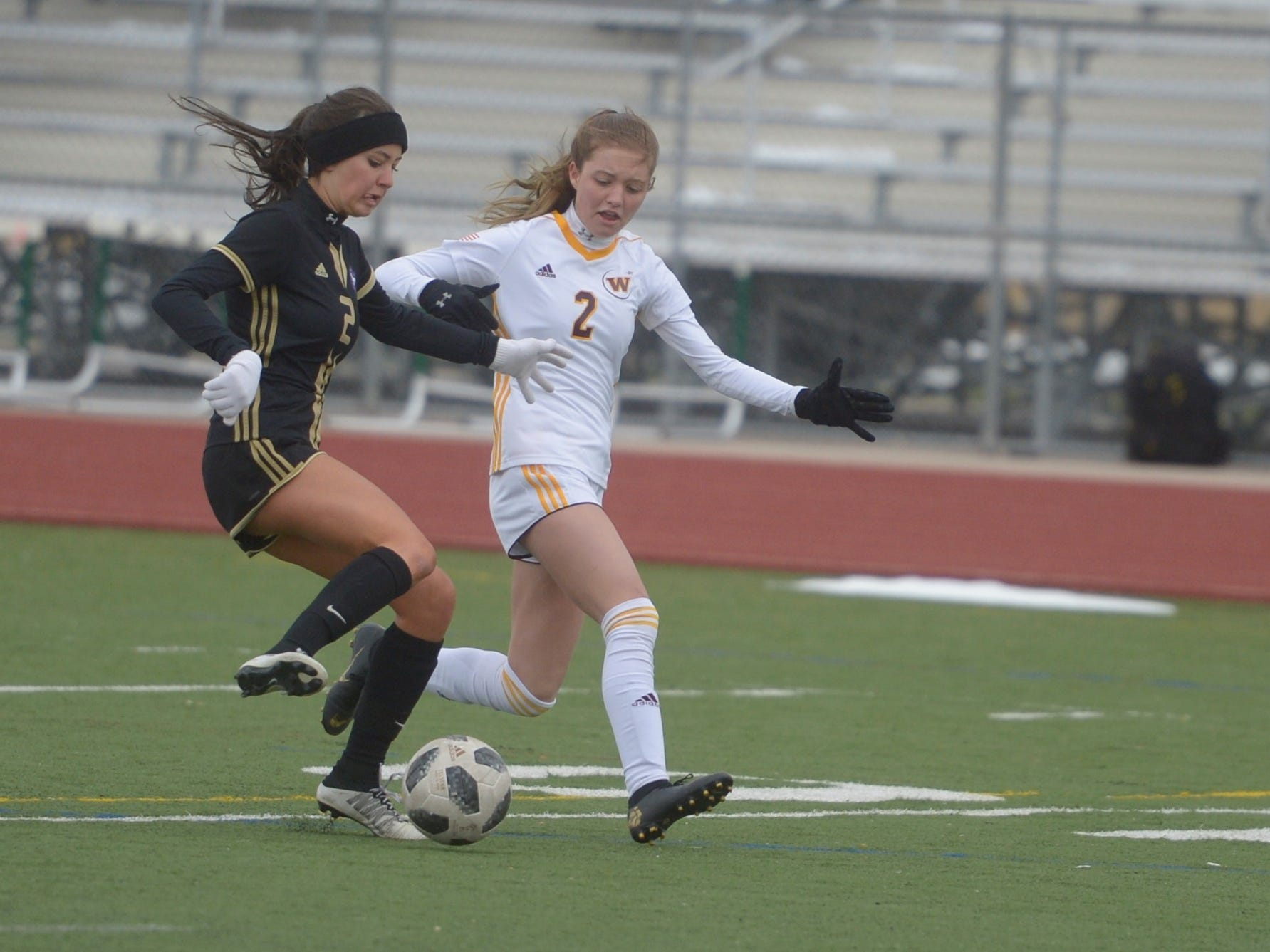 Fort Collins High School girls soccer player Annika Lamb, left, defends Windsor's Alexa Kopren in a game Saturday, April 13, 2019 at Fossil Ridge. Windsor won 3-0.