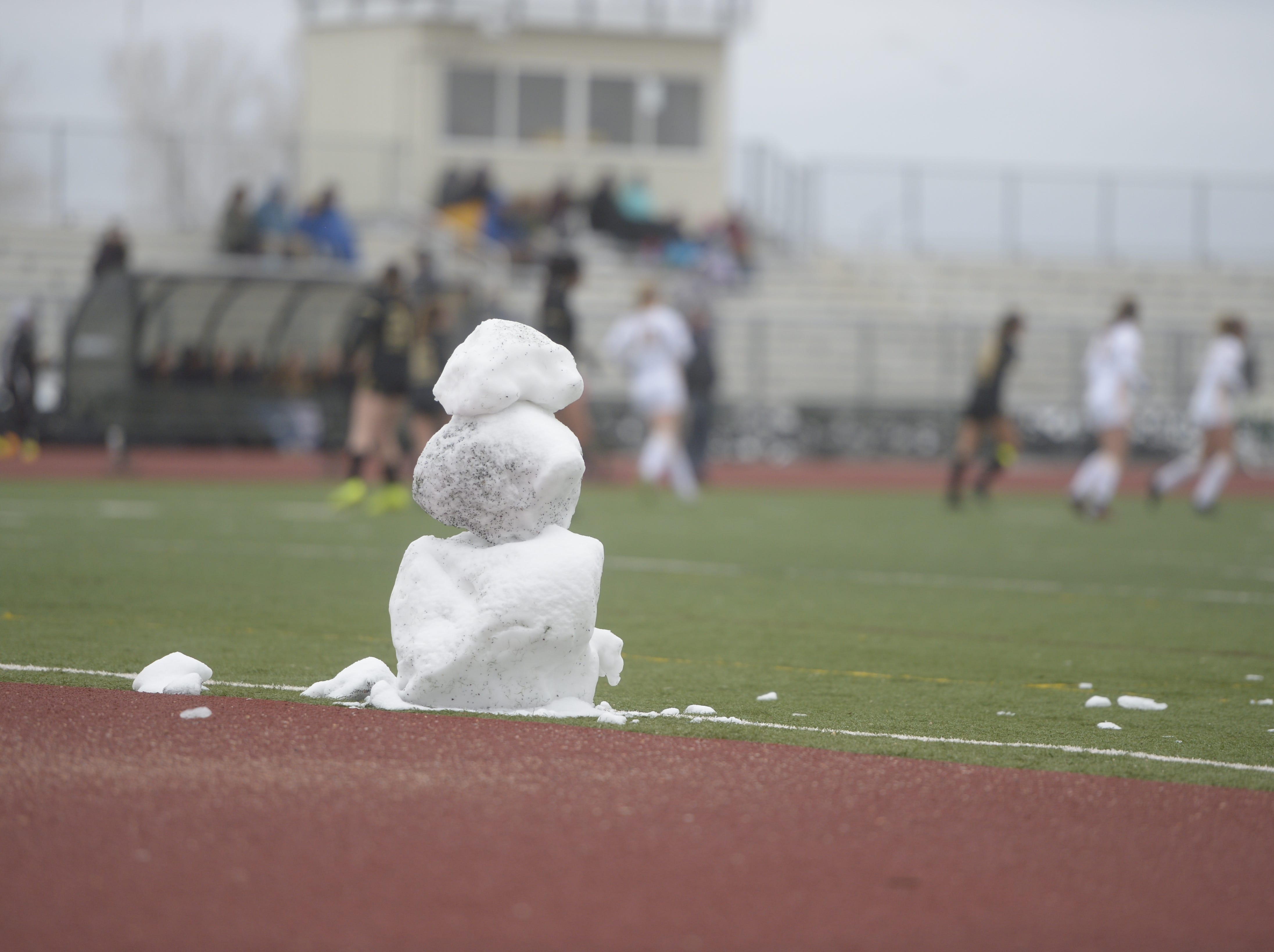 A snowman at the edge of the field as the Windsor and Fort Collins soccer teams play Saturday, April 13, 2019 at Fossil Ridge.