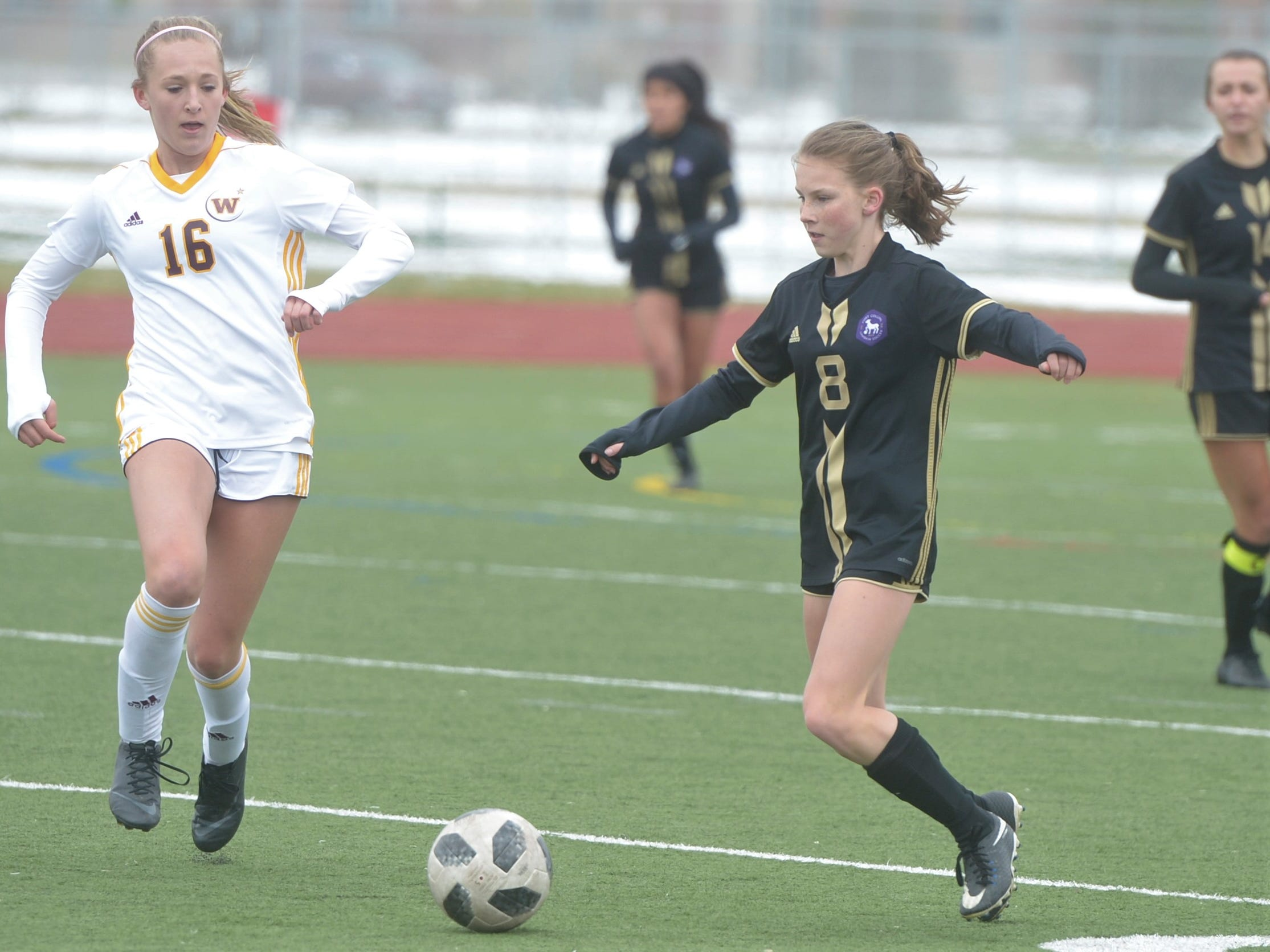 Fort Collins soccer player Annie Sullivan, right, tries to evade Windsor's Abby Bush during a game Saturday, April 13, 2019 at Fossil Ridge. Windsor won 3-0.