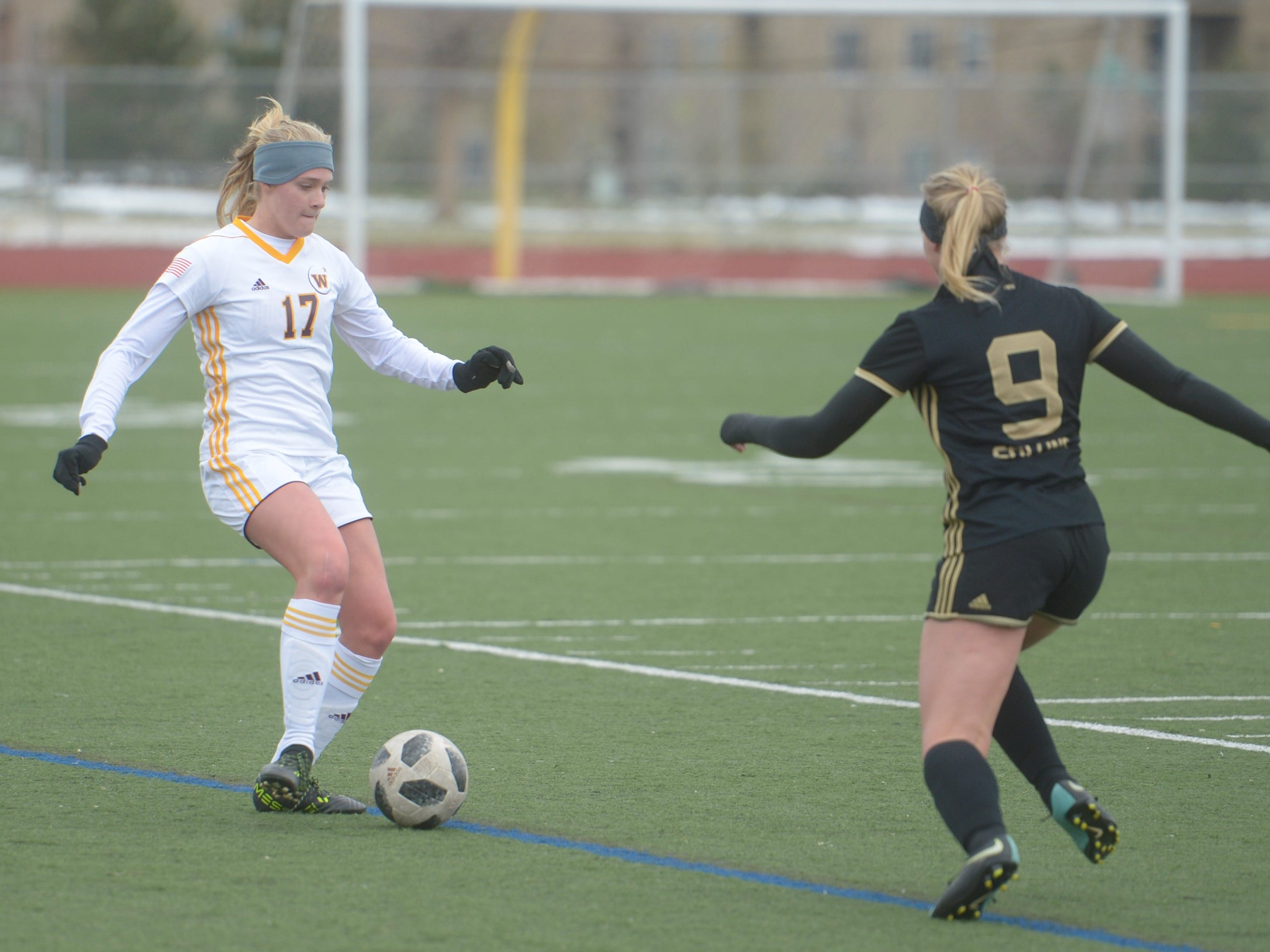 Windsor soccer player Kyndel Anderson passes the ball during a game Saturday, April 13, 2019 at Fossil Ridge. Windsor won 3-0.