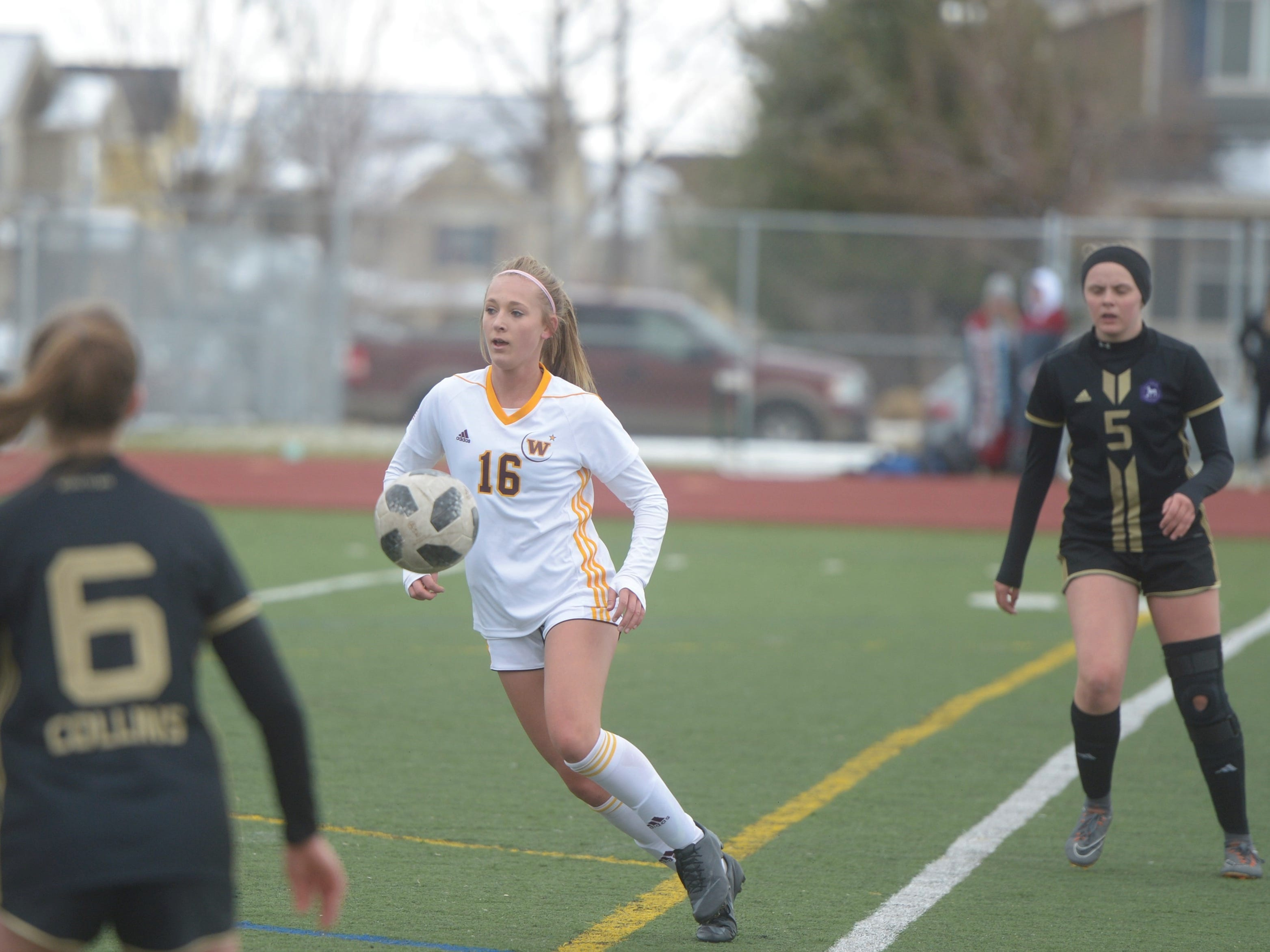 Windsor soccer player Abby Bush chases a ball during a game Saturday, April 13, 2019 at Fossil Ridge. Windsor won 3-0.