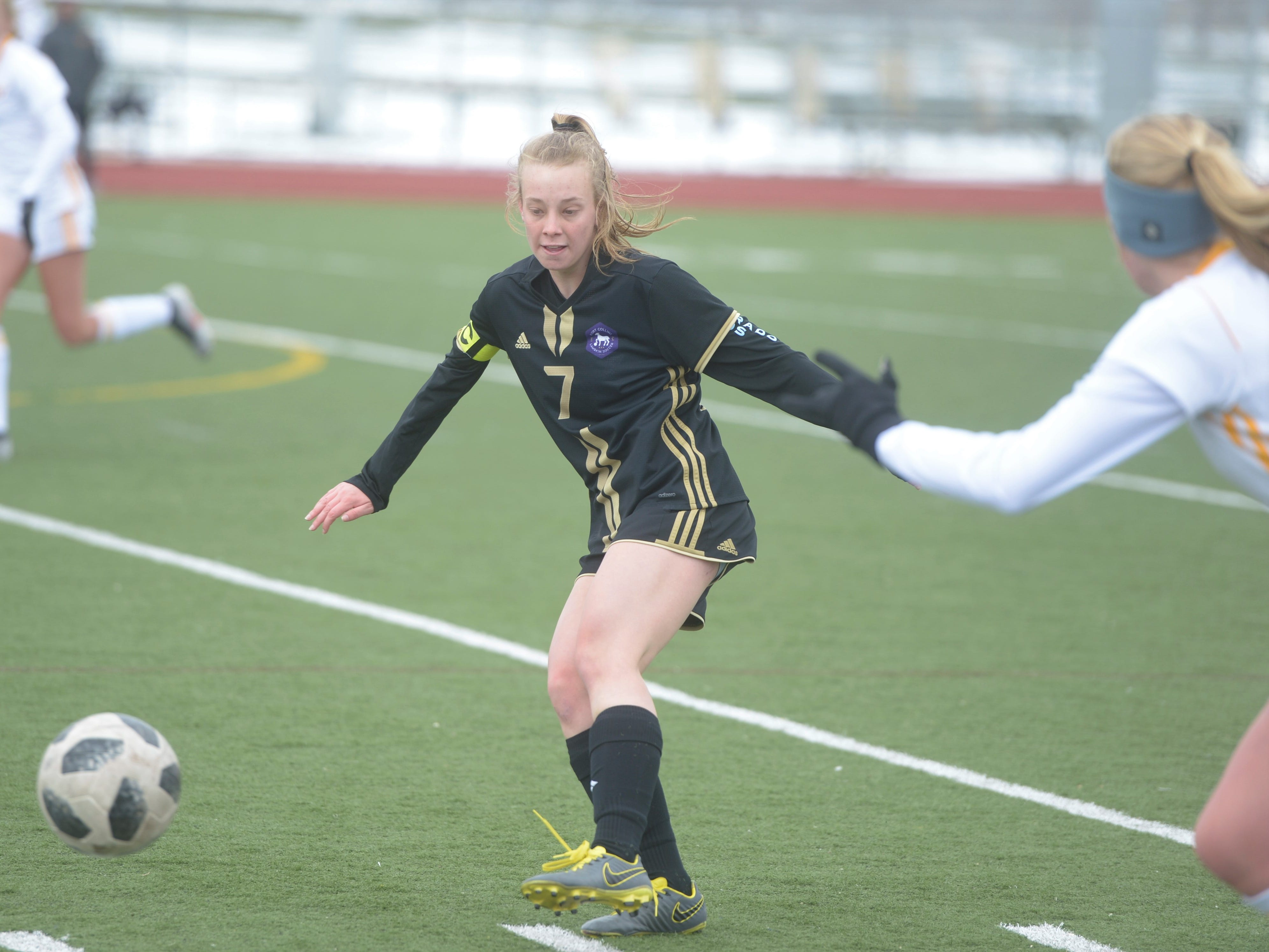 Fort Collins soccer player Gracie Rademacher passes the ball during a game against Windsor on Saturday, April 13, 2019 at Fossil Ridge. Windsor won 3-0.