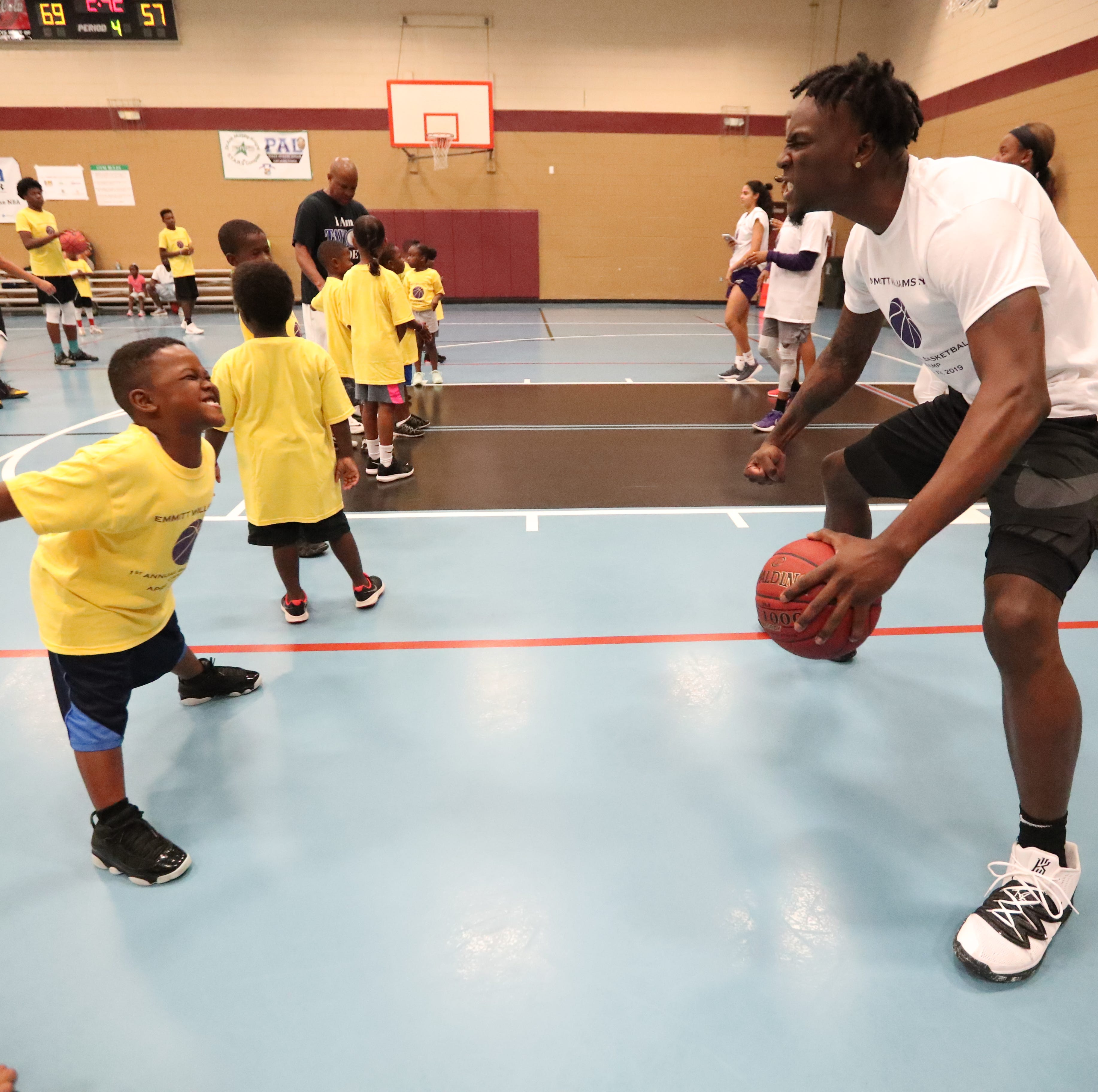LSU's Emmitt Williams, who's testing his NBA Draft prospects, holds youth basketball camp
