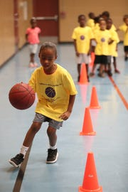 Tiana Tisme, 5, runs drills at the Emmitt Williams camp at the STARS Complex on Saturday.