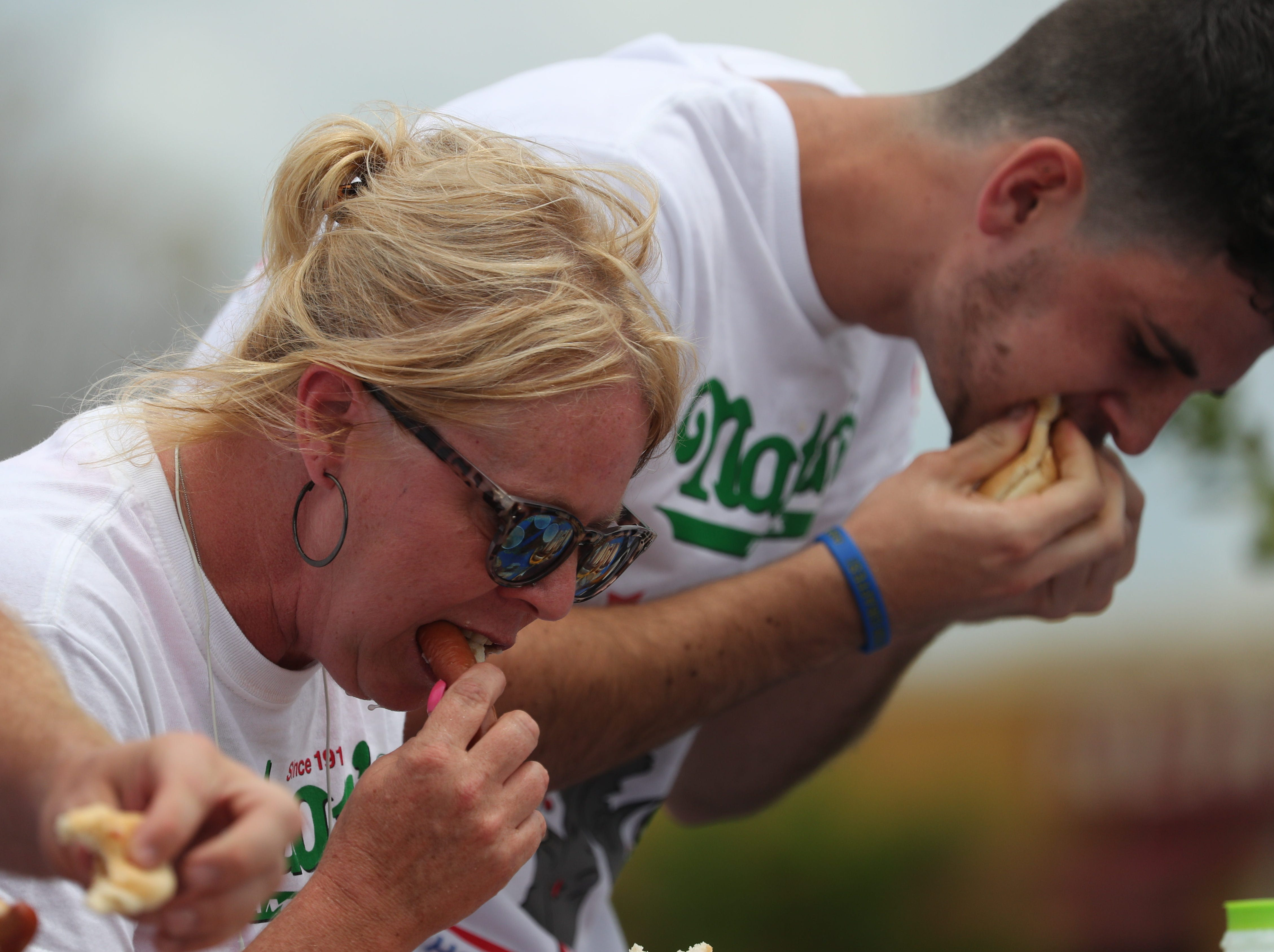 Competitors in the Nathan's Famous Hot Dog Eating Contest eat as many hot dogs as possible in ten minutes on Saturday, April 13, 2019, in Cape Coral.