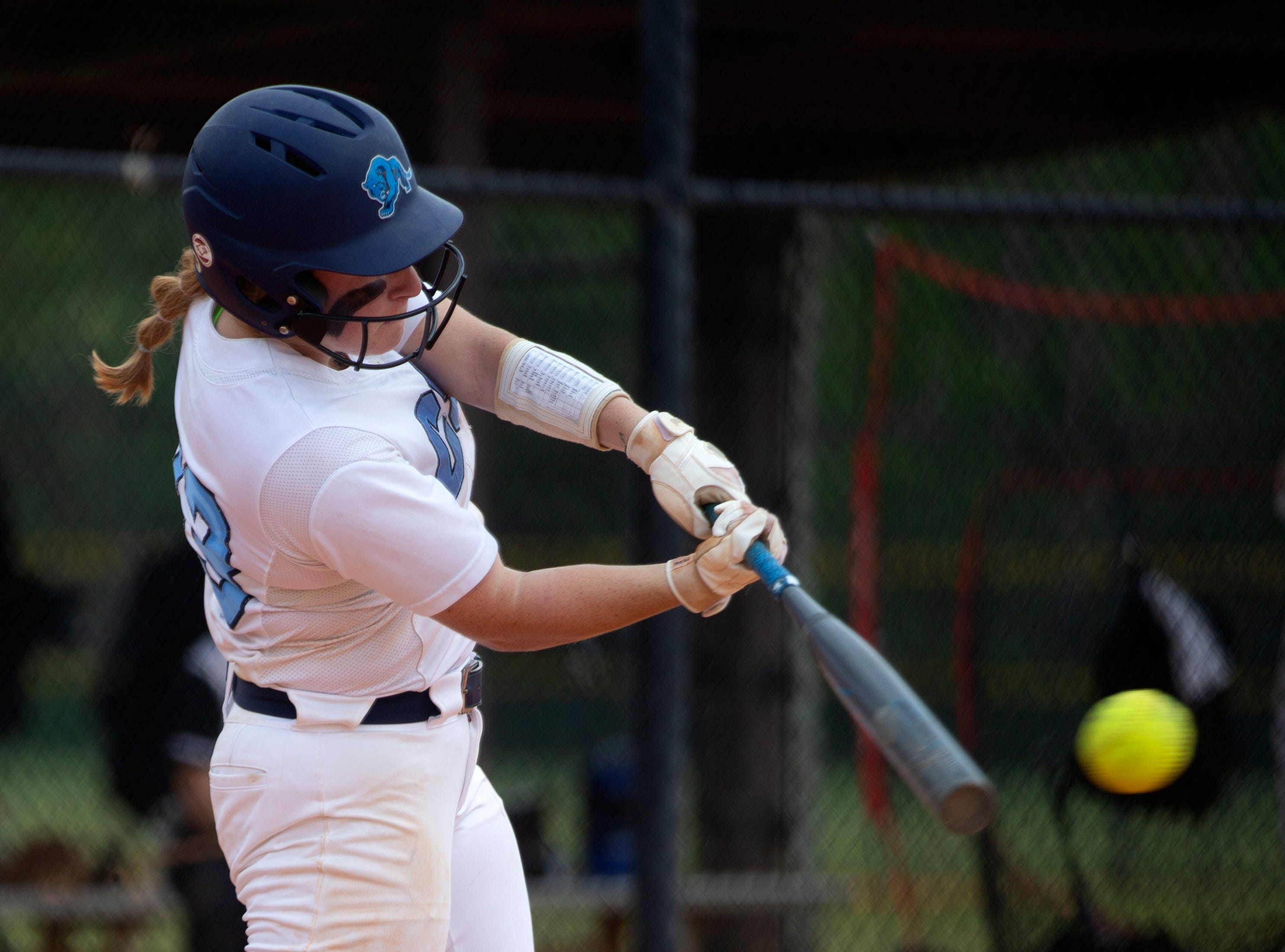 Coral Springs Charter School's Cassidy Crump connects for a base hit against Robinson during the championship game at the Longshore Memorial softball tournament, Saturday, April 13, 2019, at North Collier Regional Park in North Naples.