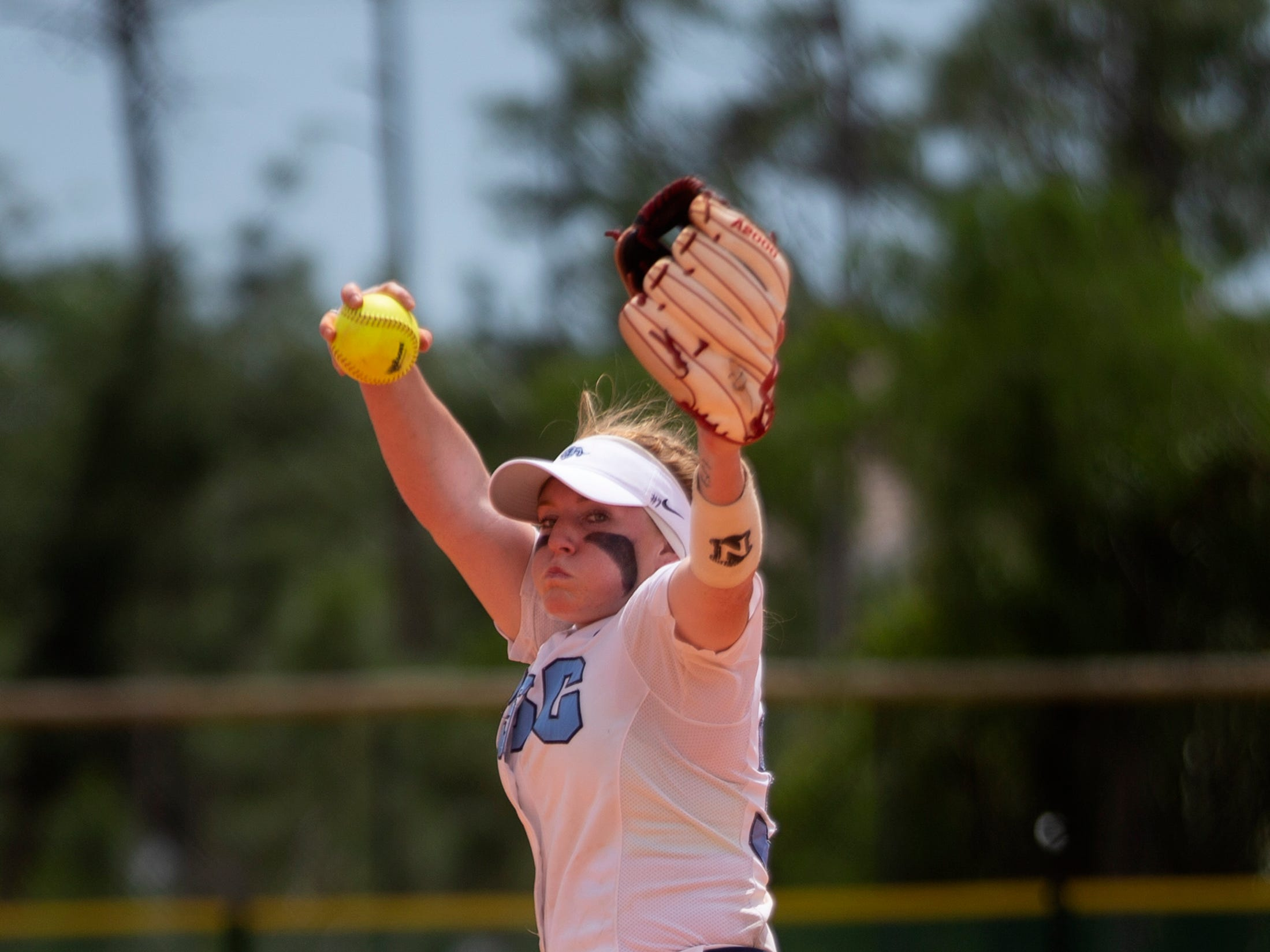 Coral Springs Charter School's Cassidy Crump delivers a pitch against Robinson during the championship game at the Longshore Memorial softball tournament, Saturday, April 13, 2019, at North Collier Regional Park in North Naples.