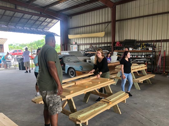 Businesses and area residents gathered in North Fort Myers Saturday to help build 57 of picnic tables, a response to the deadly March 25 hit-and-run crash at a Cape Coral bus stop that killed elementary-school-bound Layla Aiken, 8.