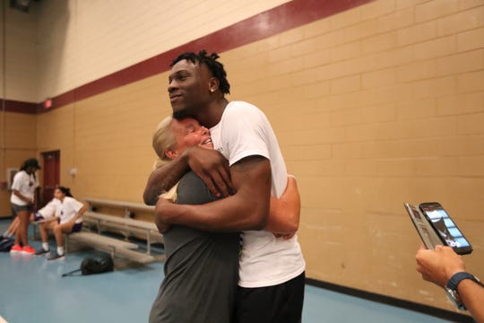 Dawn McNew, Emmitt's Williams' freshman year coach at Lehigh, gets a big hug from him at the STARS Complex Saturday during a camp he ran. She showed up to see him at the camp. Williams just finished his freshman season at LSU and declared for the NBA Draft on Thursday night.
