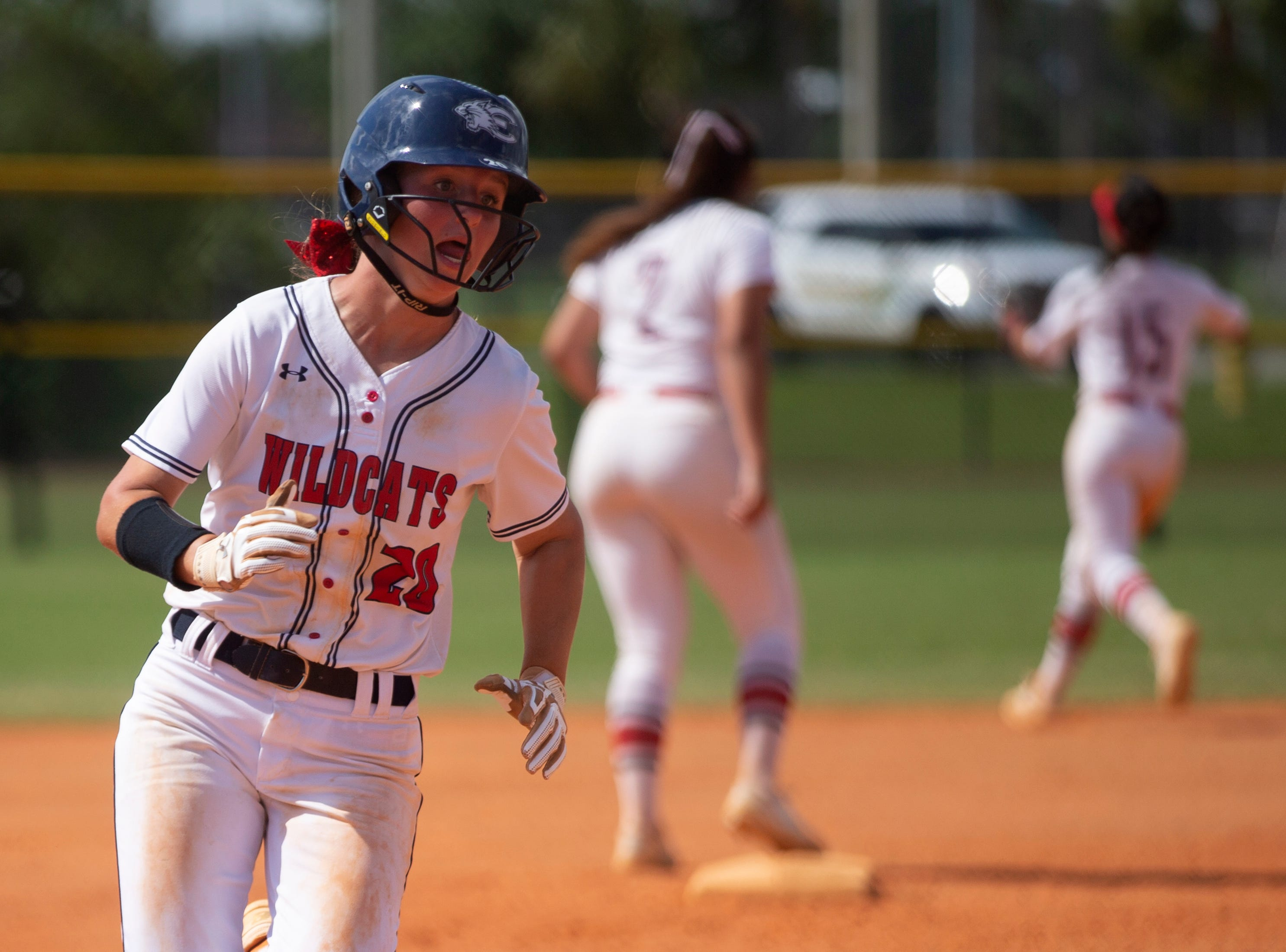 Estero's Lauren Hobbs scores a run against Dural Academy during the Longshore Memorial softball tournament, Saturday, April 13, 2019, at North Collier Regional Park in North Naples.