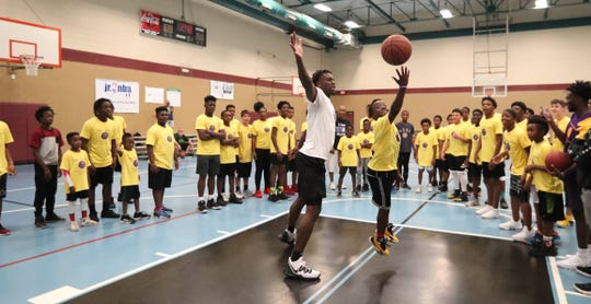 Jardarian Gayle, 13, takes on Emmitt Williams on a break. Emmitt Williams, a Fort Myers native who played at Lehigh his freshman year and just finished his freshman season at LSU, declared for the NBA Draft on Thursday night. Williams hosted a youth camp at the STARS Complex on Saturday.