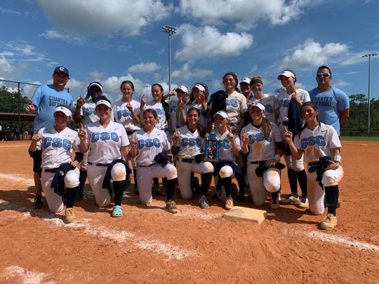 The Coral Springs Charter softball team celebrates after winning the Longshore Championship on Saturday. Coral Springs defeated Tampa-Robinson 10-0.