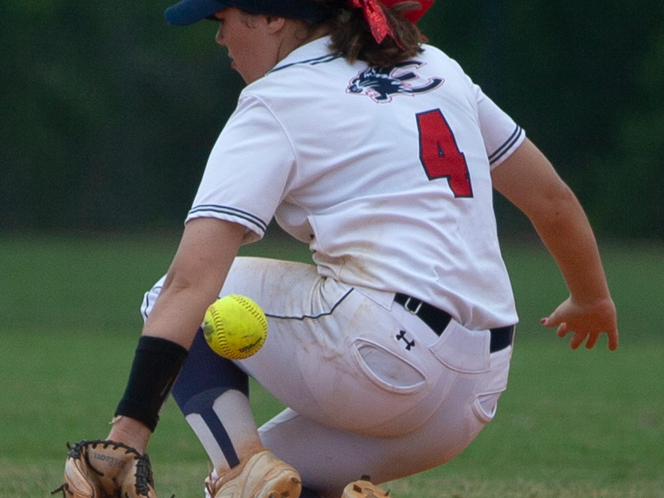 Estero's Anna Raybuck fields the ball against Doral Academy during the third place game at the Longshore Memorial softball tournament, Saturday, April 13, 2019, at North Collier Regional Park in North Naples.