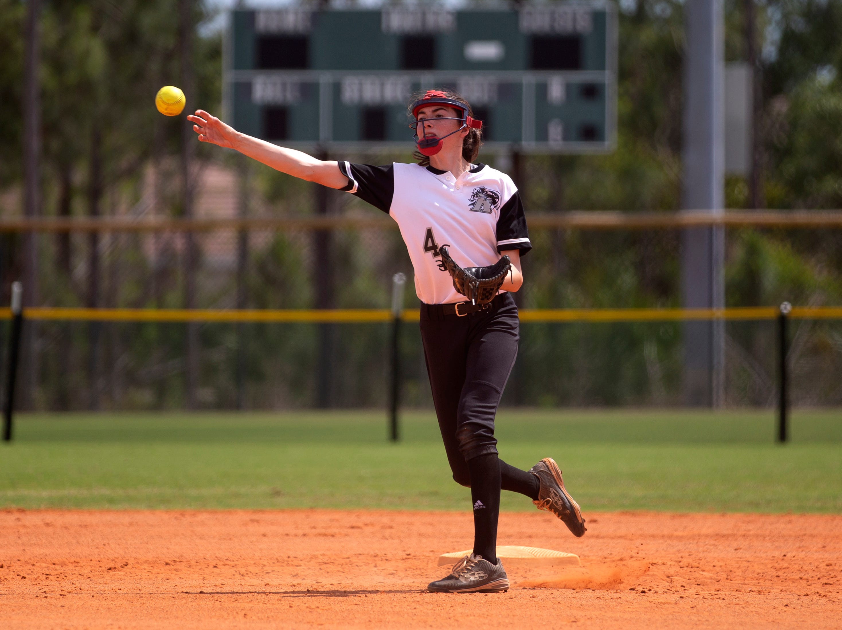 Robinson's Jocelyn Campo fields the ball to home during the champions ship game against Coral Springs Charer School at the Longshore Memorial softball tournament, Saturday, April 13, 2019, at North Collier Regional Park in North Naples.