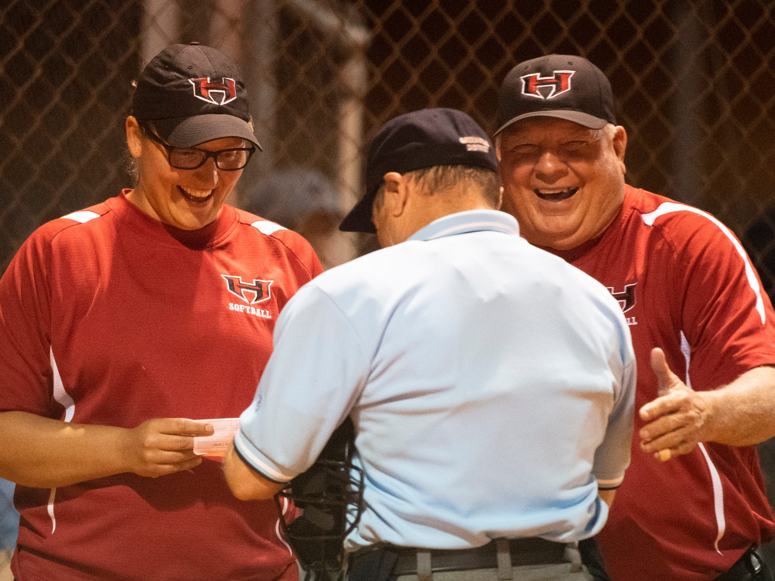 Hillcrest's coaches Kristen Brust and Larry Wooten talks to the umpire during the game at Hillcrest Friday, April 12, 2019.