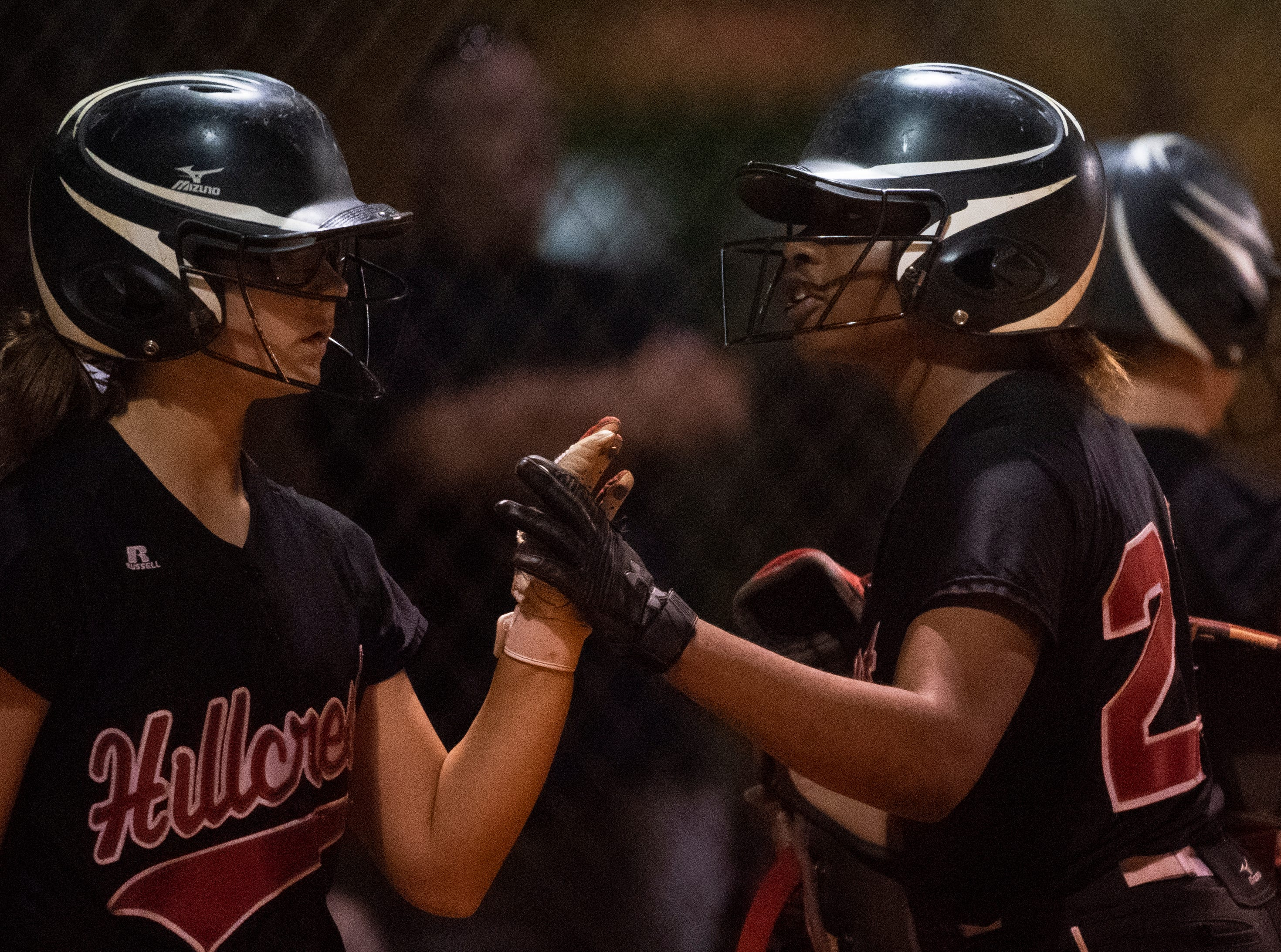 Hillcrest's Alexis Hargrove (24) (right) and Hannah Stevens (99) slap hands at home plate after Hargrove scored a run during the game against Boiling Springs High School at Hillcrest Friday, April 12, 2019.