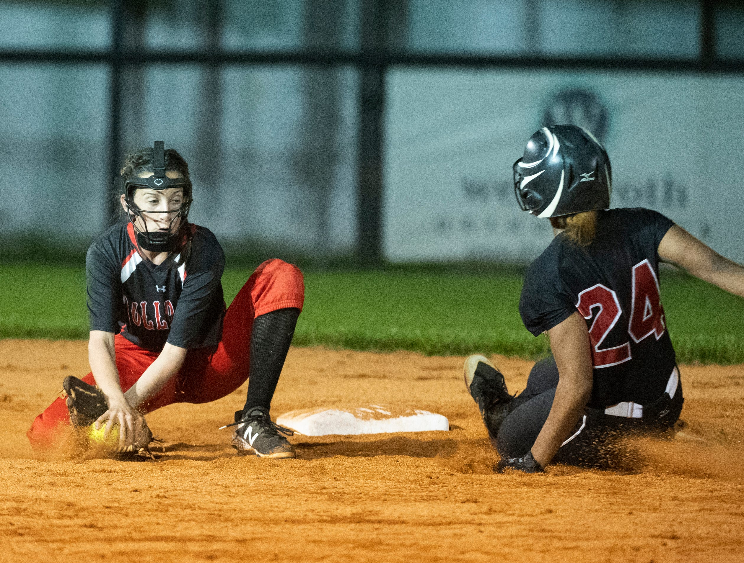 Hillcrest's Alexis Hargrove (24) is safe at second base while Boiling Springs' Alexis McFalls (6) gets the ball during the game at Hillcrest Friday, April 12, 2019.