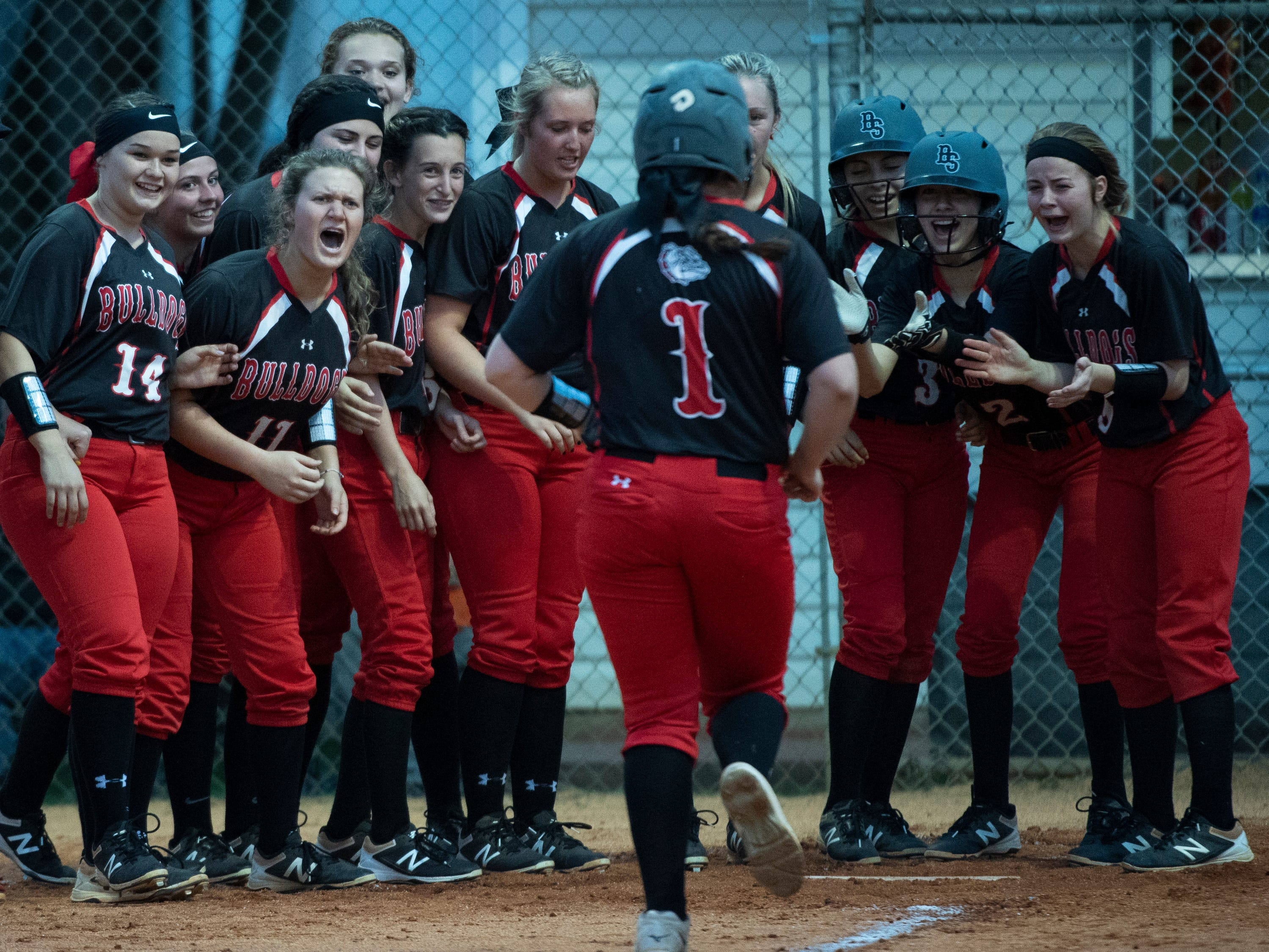 The Boiling Springs High School dugout celebrates Boiling Springs' Olivia Hall's (1) home run during the game at Hillcrest Friday, April 12, 2019.