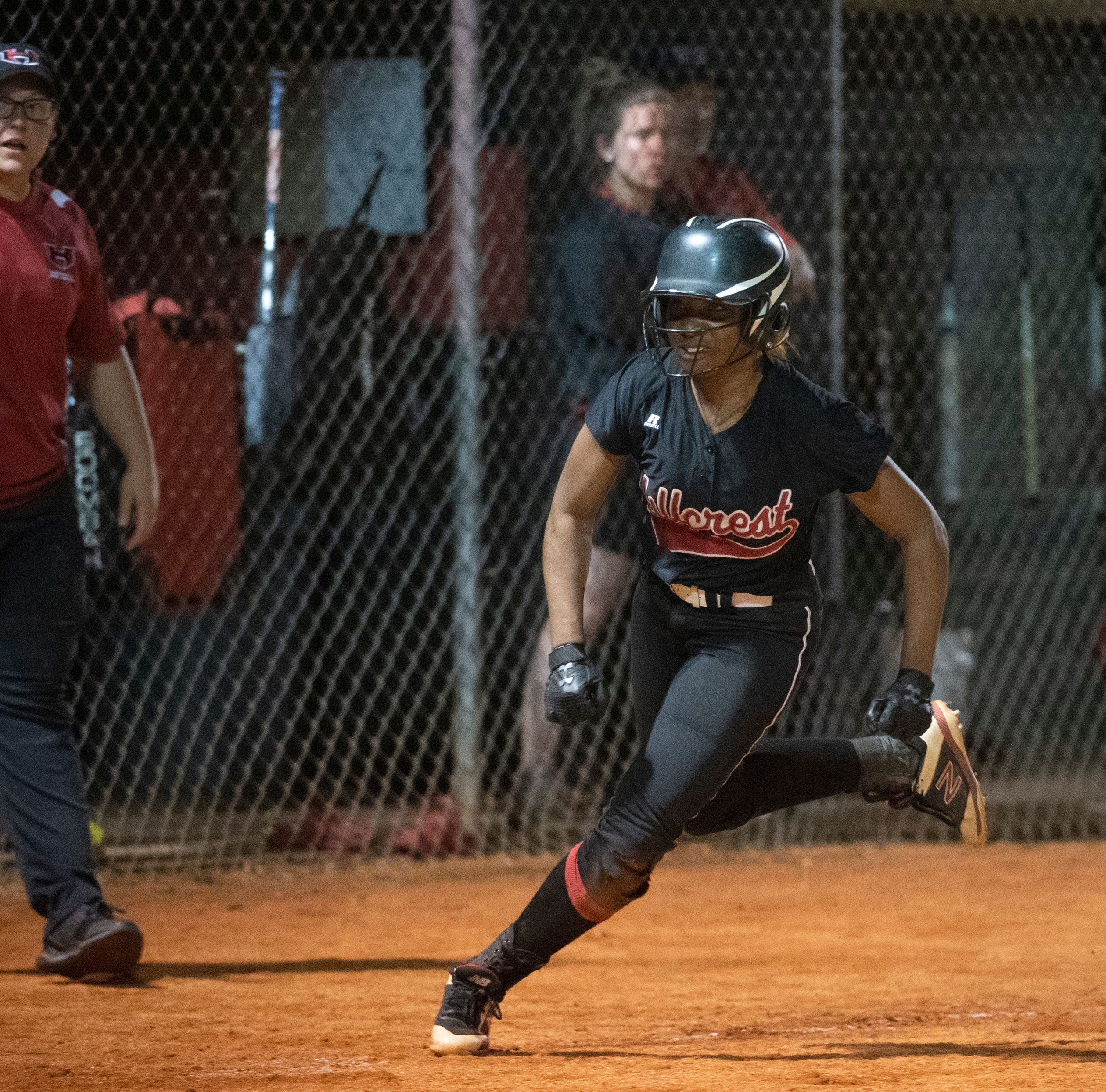 Hillcrest's Alexis Hargrove (24) runs home to score against Boiling Springs High School during the game at Hillcrest.