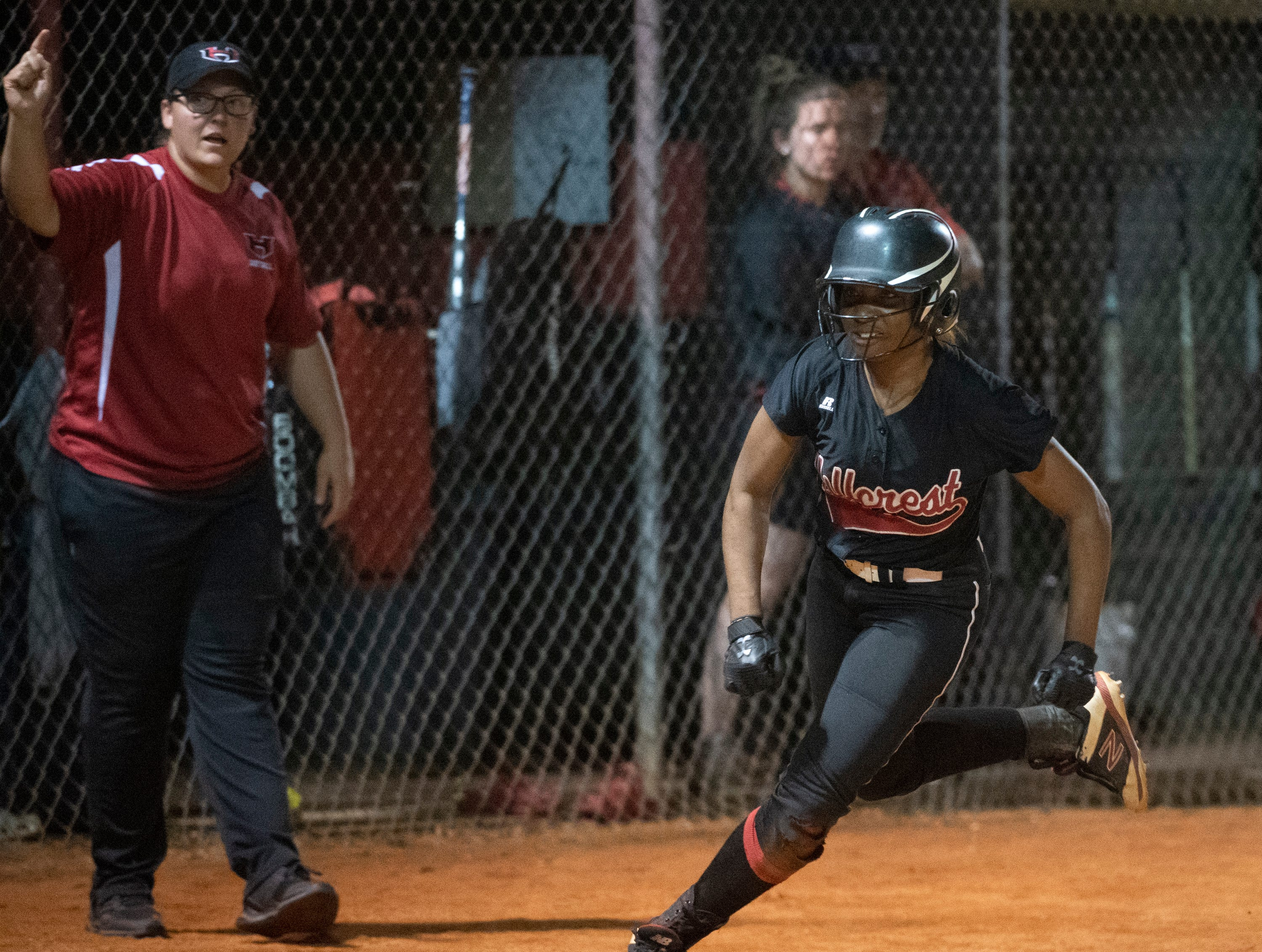 Hillcrest's Alexis Hargrove (24) runs home to score against Boiling Springs High School during the game at Hillcrest Friday, April 12, 2019.