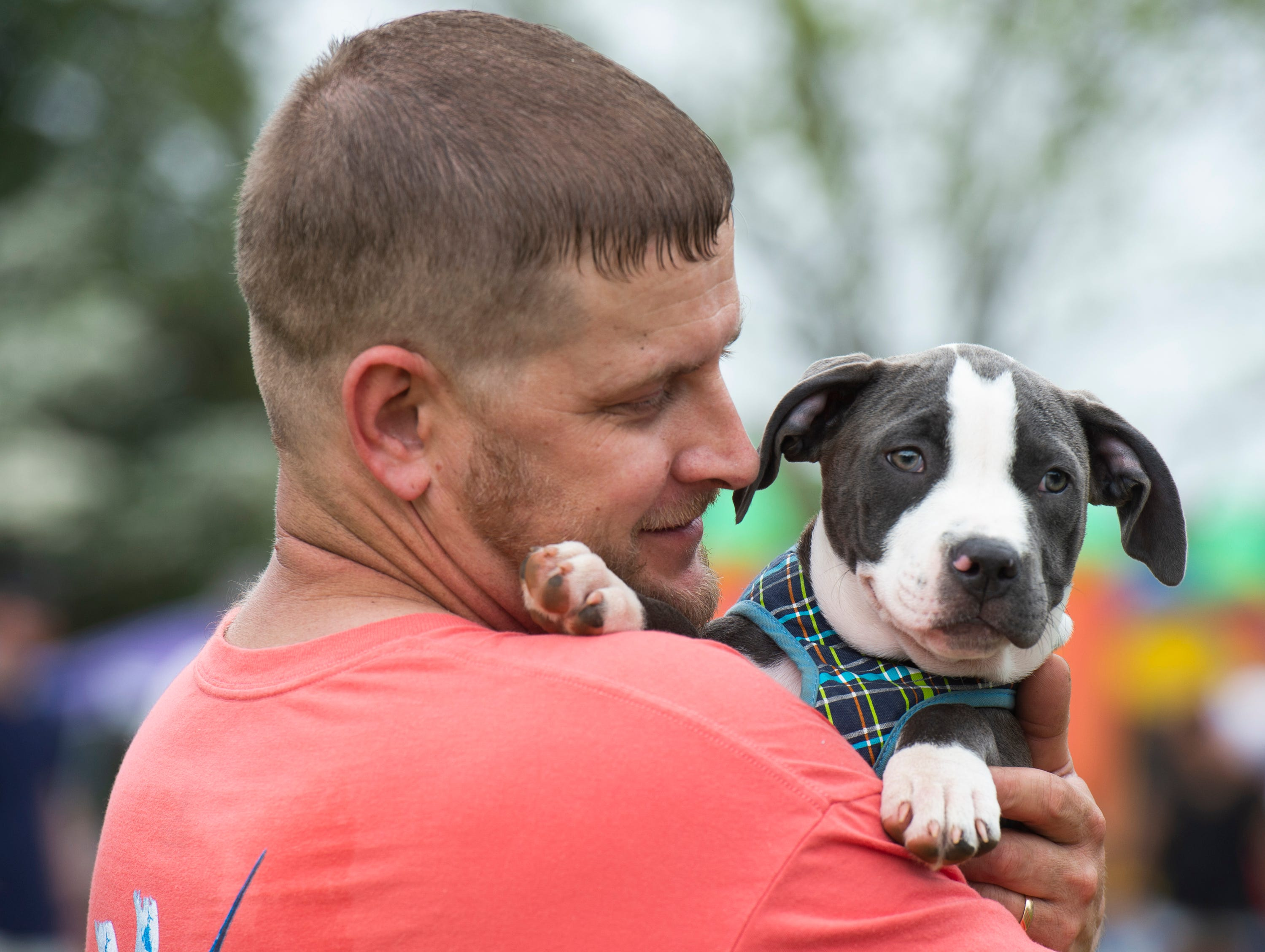Michael Center, of Laurens, holds Nala, while competing in the cutest dog category during Paws for a Cause at Simpsonville City Park Saturday, April 13, 2019.