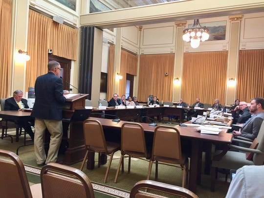 John MacDonald, Montana Newspaper Association lobbyist, objects Saturday to how a bill is being processed by the Senate Finance and Claims Committee.