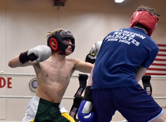 CMR's Logan Richard and Great Falls High's Braeden Lomas fight in the 2019 Crosstown Rumble on Friday night at Paris Gibson Education Center.