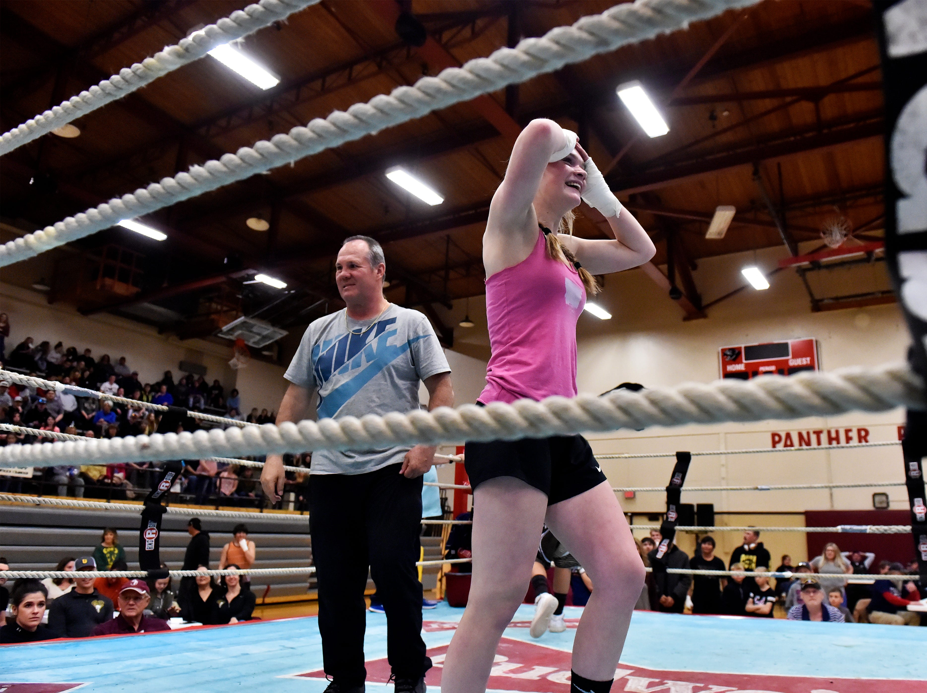 Great Falls High's Alexis Hoey enjoys the applause from the Great Falls student section after boxing match victory in 2019 Crosstown Rumble, Friday night at Paris Gibson Education Center.