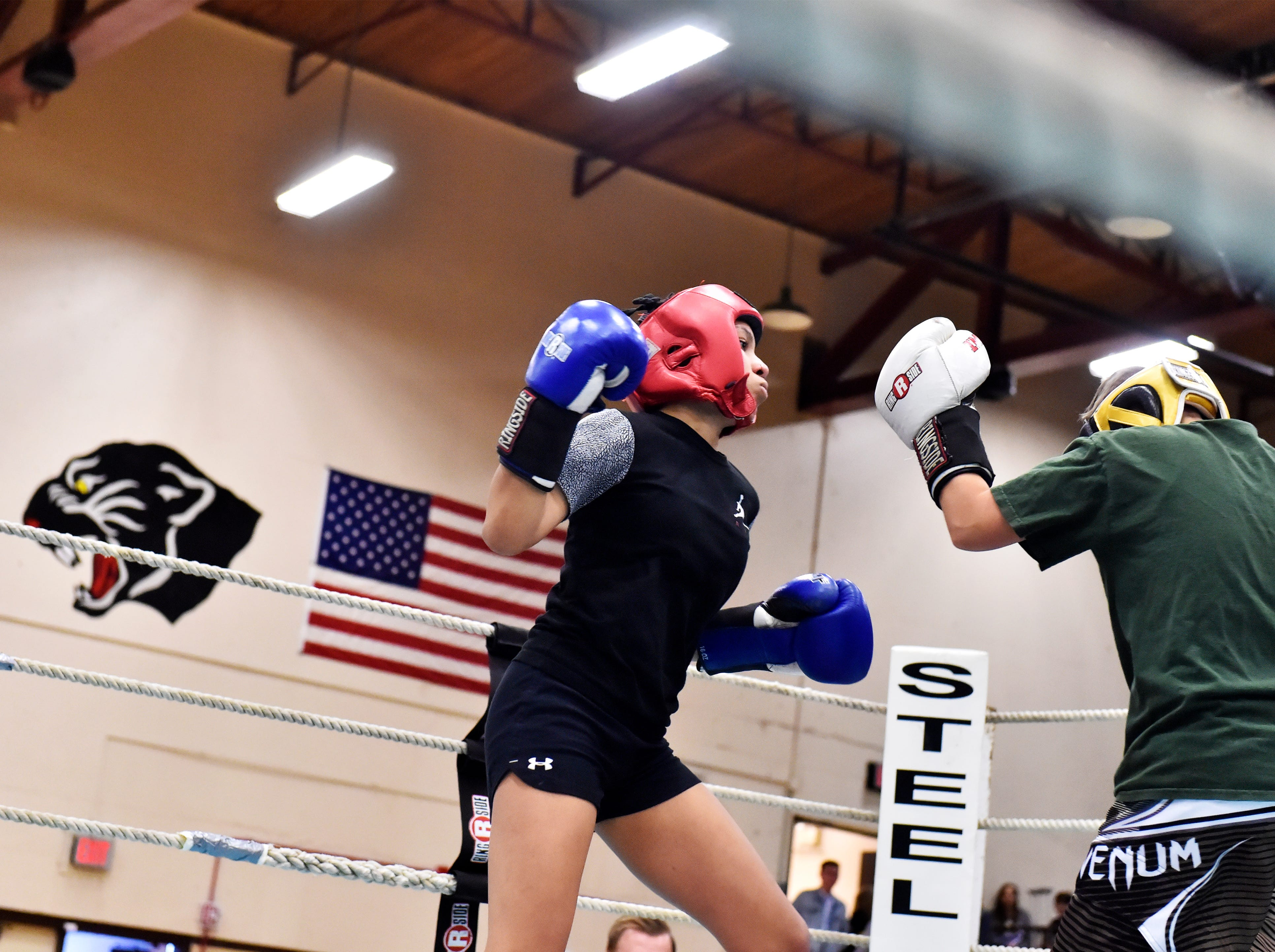Fighters from Great Falls High and CMR battle it out in the 2019 Crosstown Rumble, Friday night at Paris Gibson Education Center.