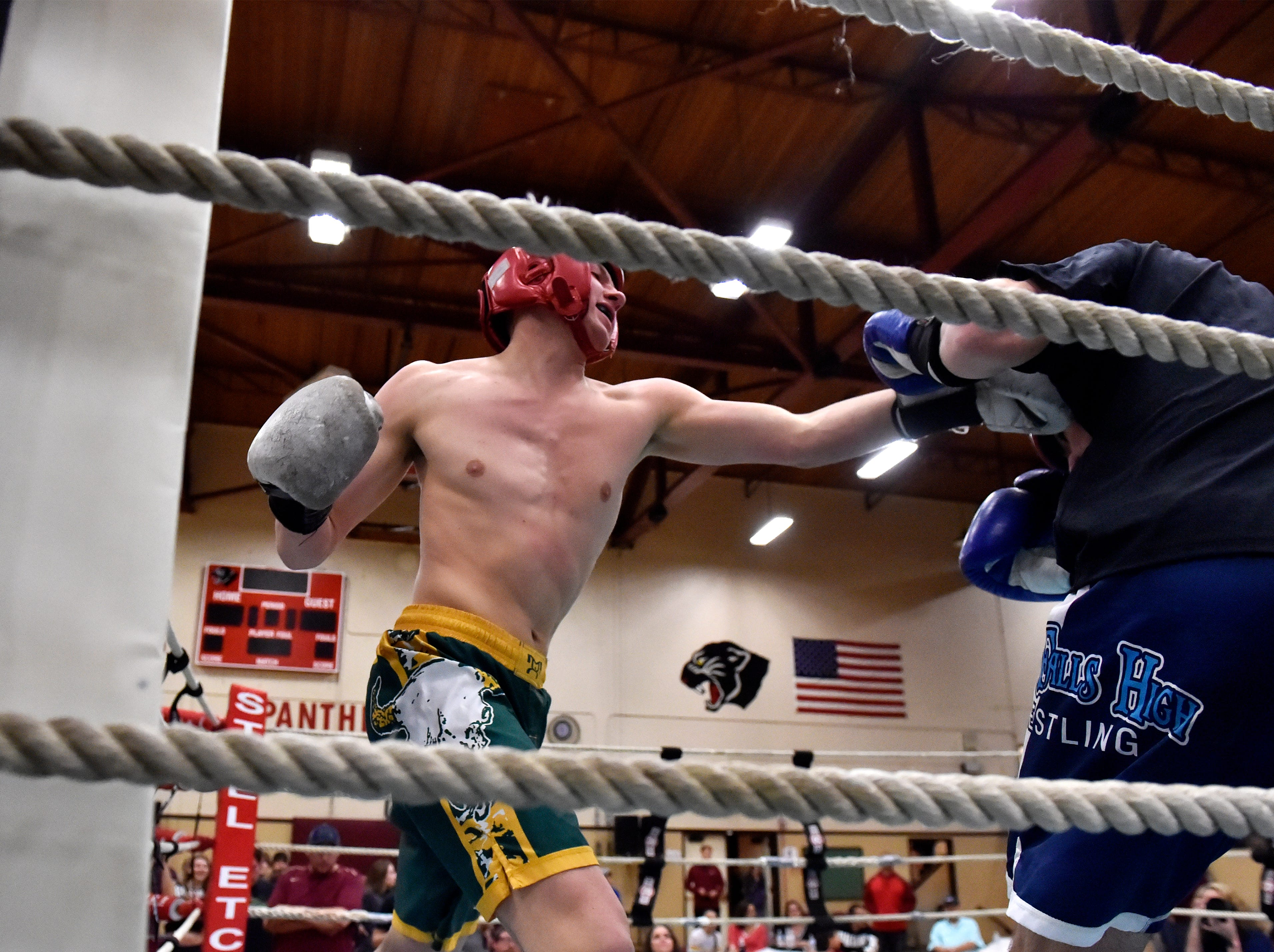 CMR's Lucas Ross throws a punch in his boxing match against Great Falls Caden Hilliard during the 2019 Crosstown Rumble, Friday night at Paris Gibson Education Center.
