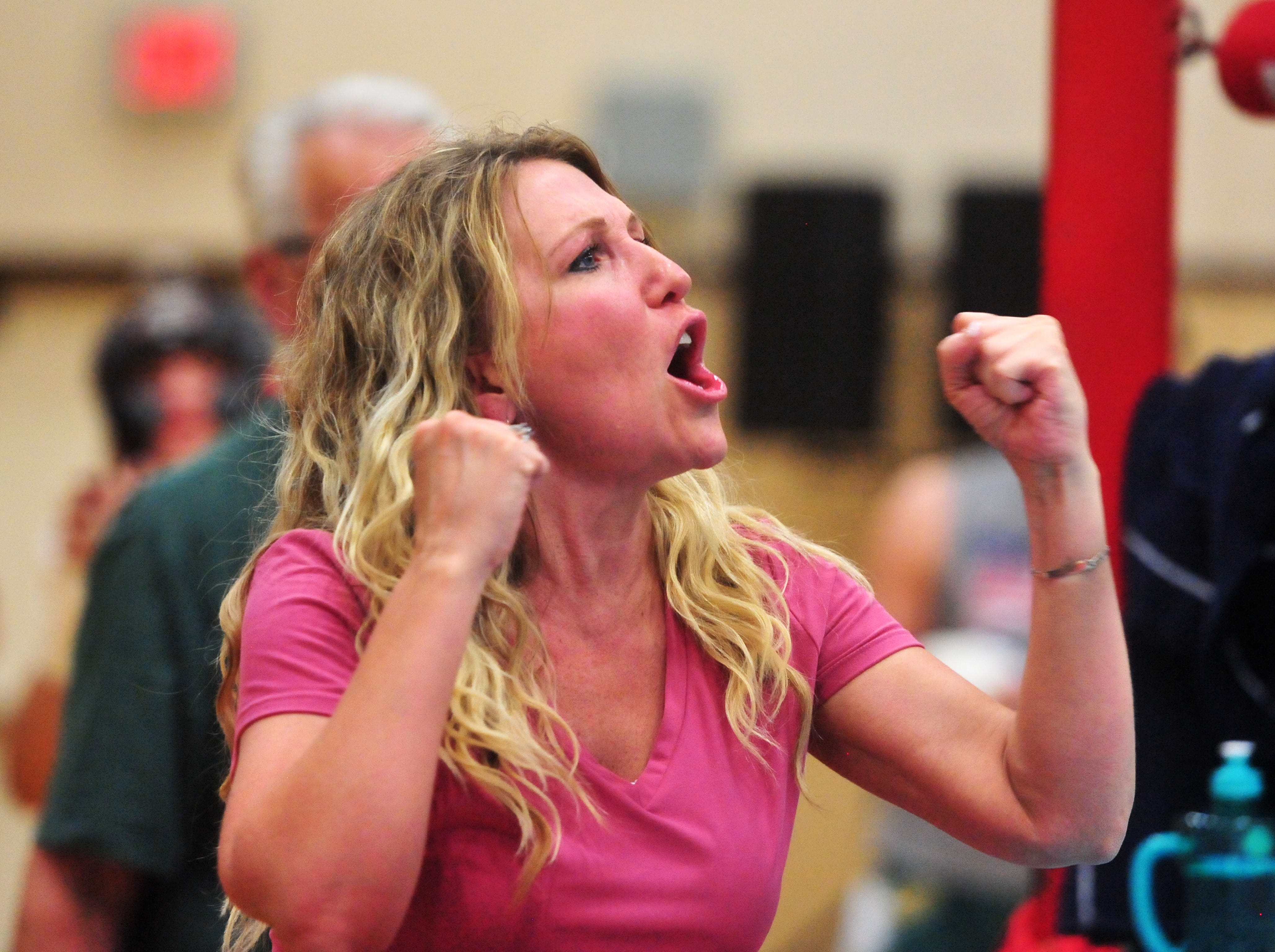 Autumn Crawford encourages fighters as they battle it out in the 2019 Crosstown Rumble, Friday night at Paris Gibson Education Center.