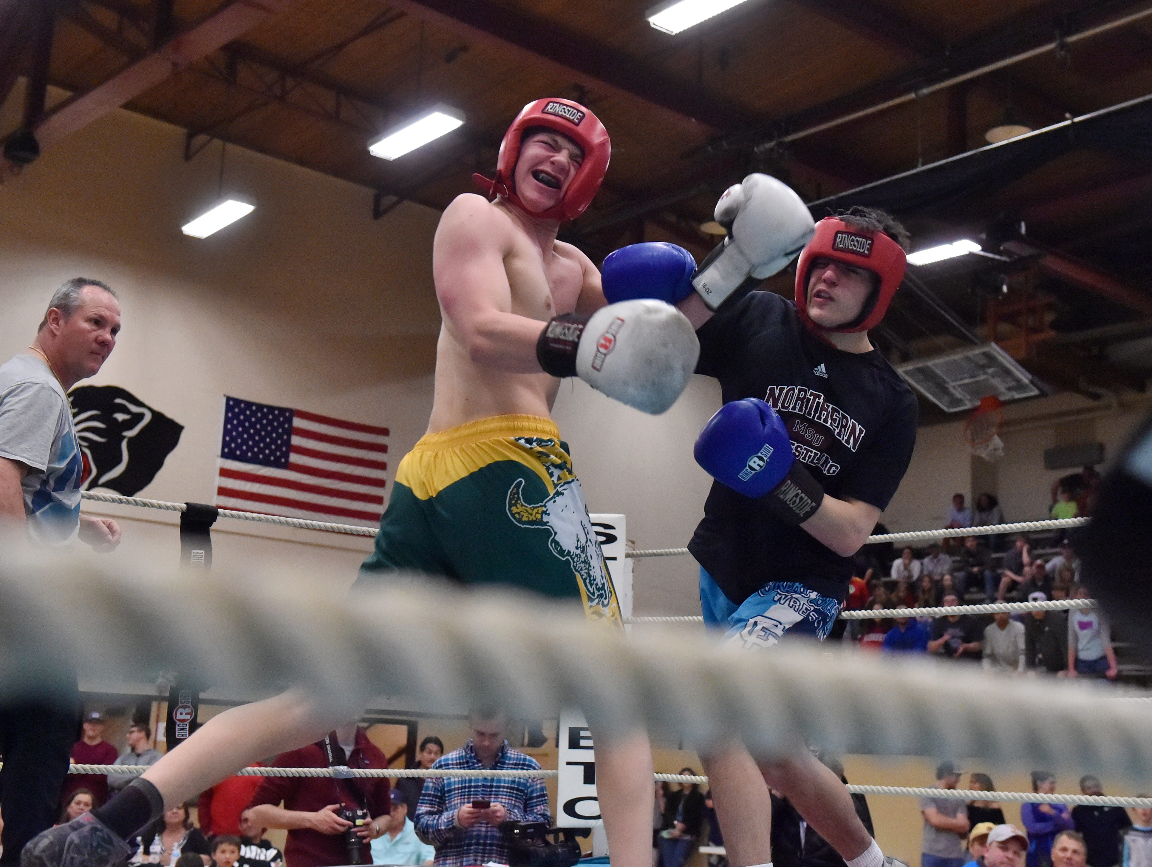 Great Falls High's Caden Hilliard and CMR's Lucas Ross fight during the 2019 Crosstown Rumble, Friday night at Paris Gibson Education Center.