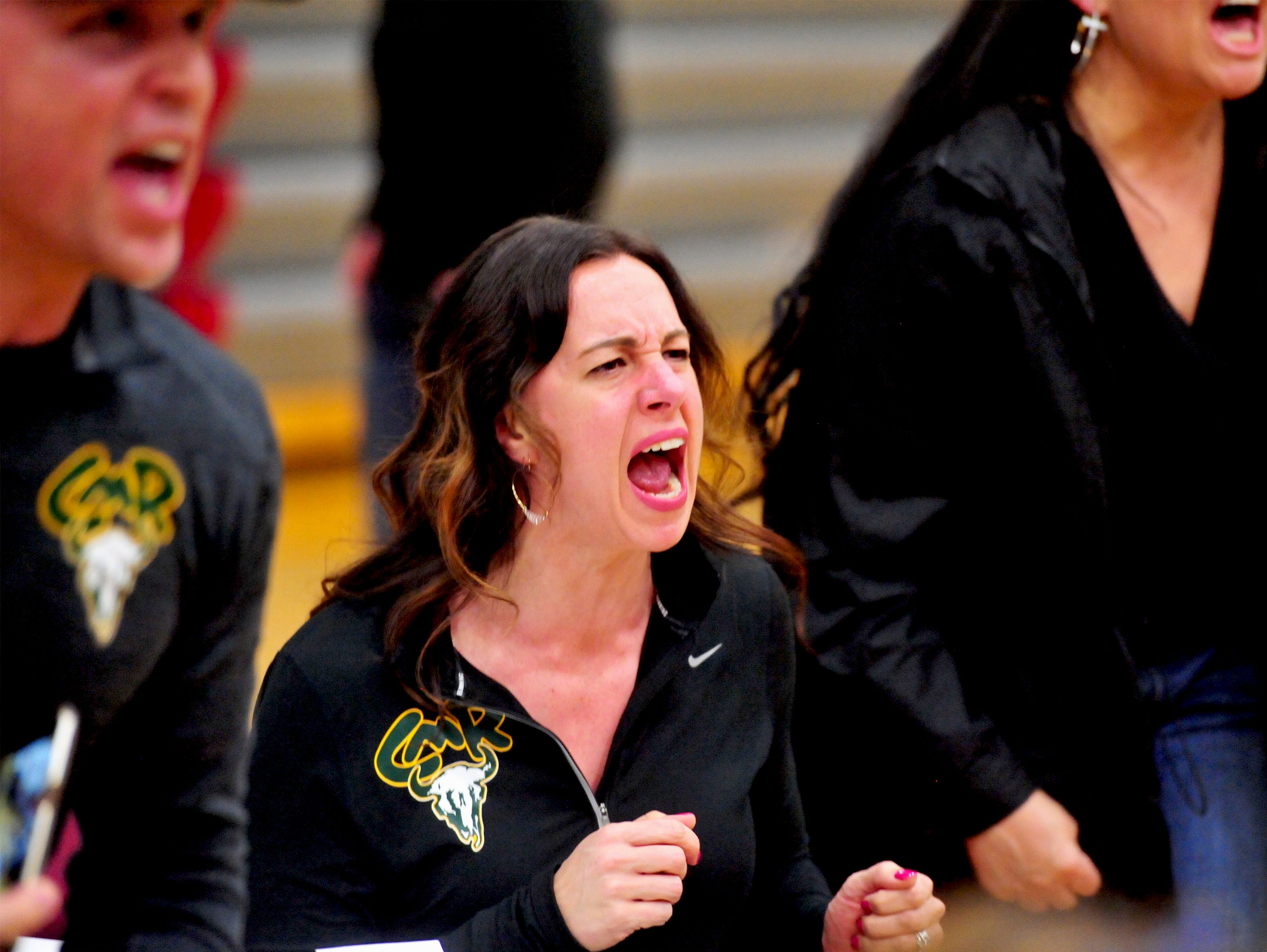 Leslie Simonson cheers on her son Jackson during the 2019 Crosstown Rumble, Friday night at Paris Gibson Education Center.