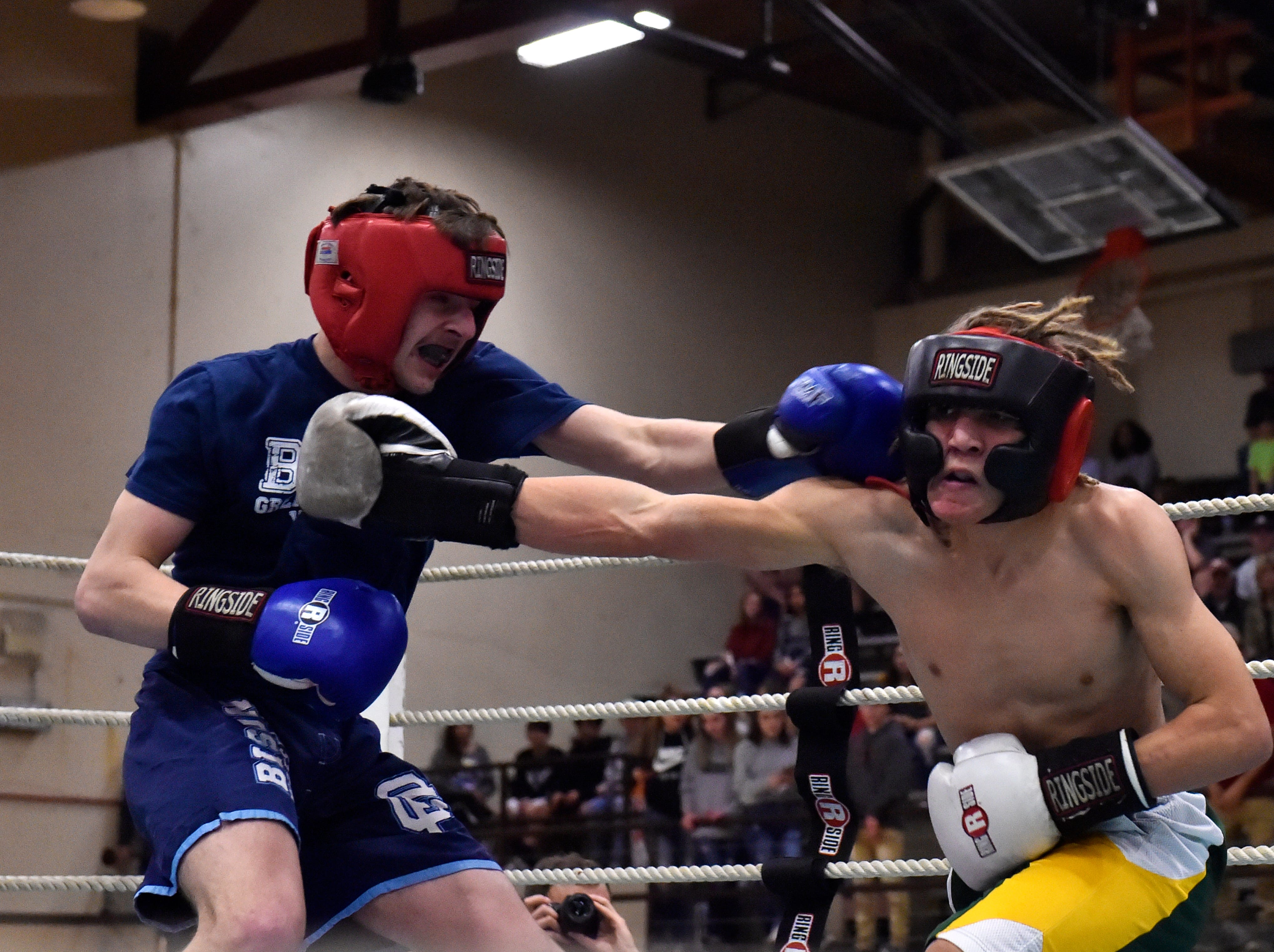 Great Falls High's Braiden Lomas and CMR's Logan Richard fight in the 2019 Crosstown Rumble on Friday night at Paris Gibson Education Center.