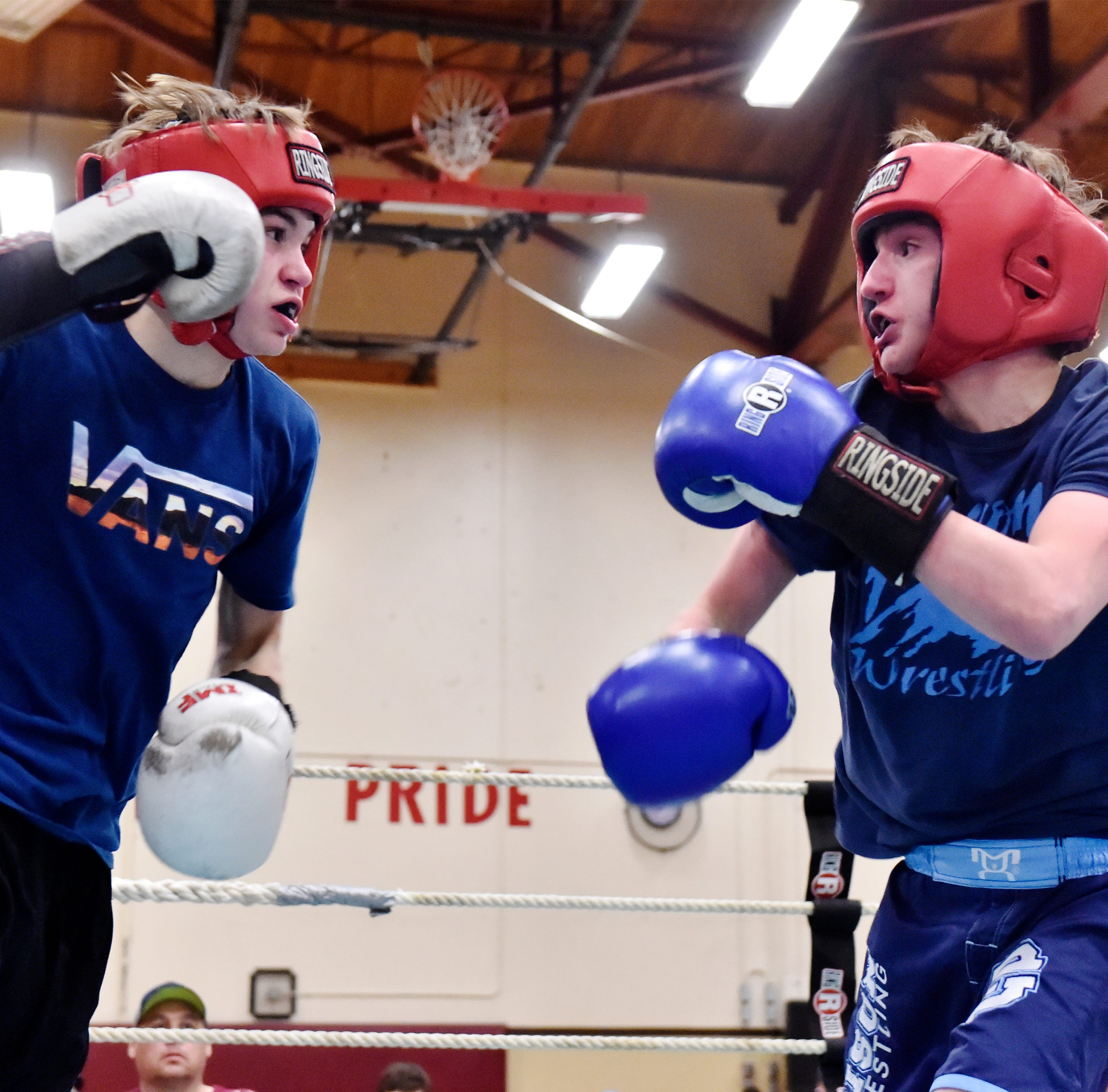Bison boxers rumble past Rustlers at crosstown smoker