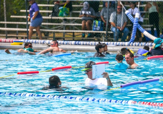 Special Olympians are assisted by their family and other volunteers during a practice session at the Hagåtña Pool on Saturday, April 13, 2019. A ceremonial ribbon cutting was held earlier in the day to celebrate the reopening of the pool, since its closing for repairs in November, last year, said Richard Ybanez, Department of Parks and Recreation acting director.