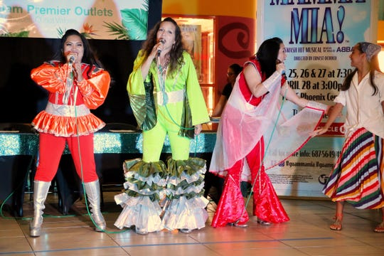 """From left, Richel Velasco Mejares, Lisa Bordallo and Veronica Flores, who will star in the popular musical """"Mamma Mia!"""" sing """"Super Trouper,"""" giving the lunchtime crowd a sneak peek on Saturday, April 13, 2019 at the Guam Premier Outlets. Catch the full """"Mamma Mia!"""" production live on April 25, 26, 27 and 28."""
