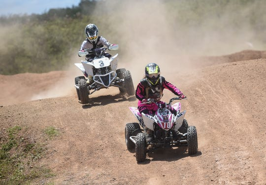 Shun Ito (3) trails Sachi Tamura (18) during their mini ATV race in the 39th Annual APL Smokin' Wheels at the Guam International Raceway in Yigo, April 13, 2019.