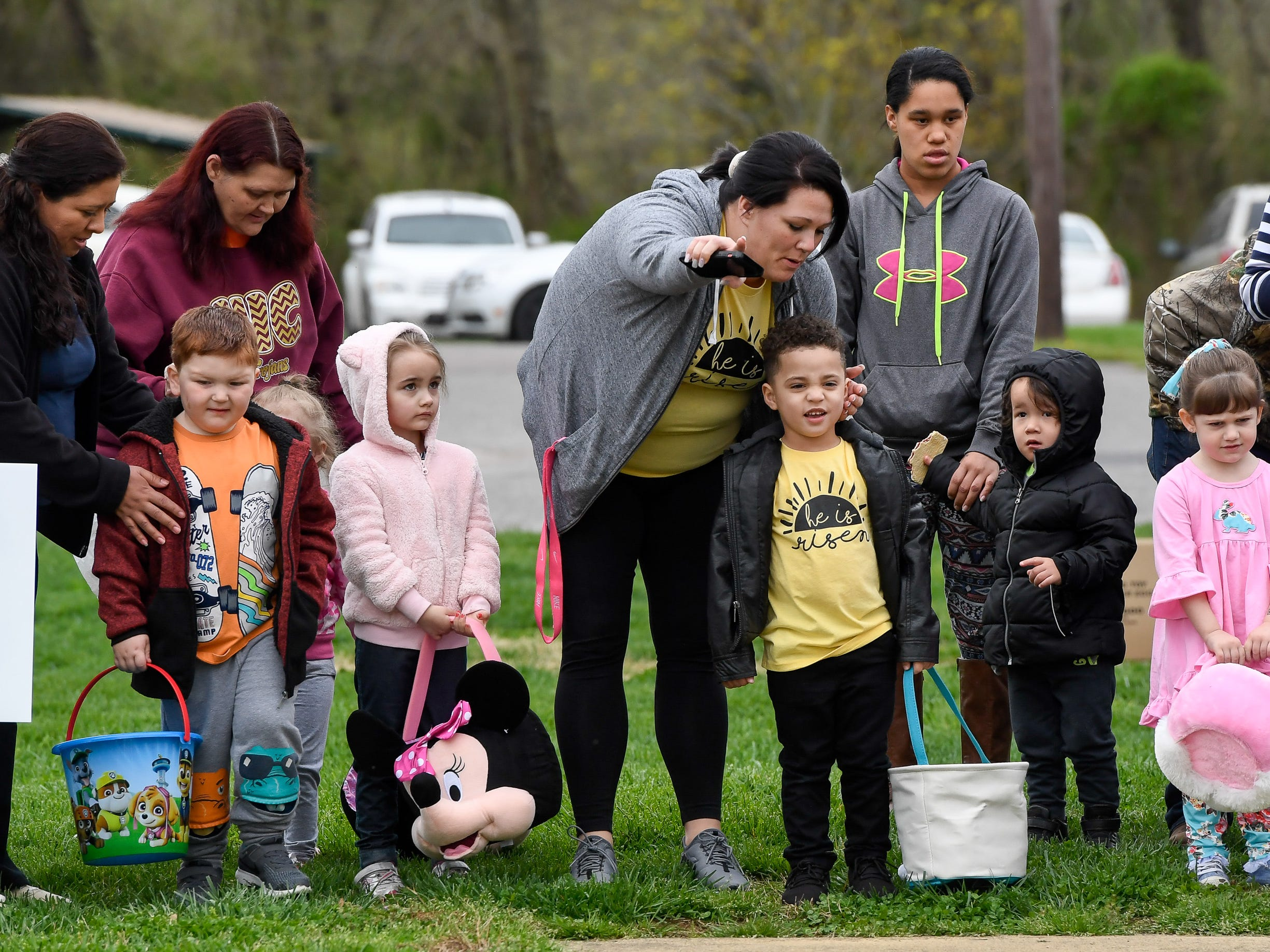 Egg hunters receive last minute instructions as children prepare to scramble for the more than 15,000 eggs hidden away in Community Park for the City of Henderson Parks and Recreation Department's annual Easter Egg Hunt Saturday, April 13, 2019.